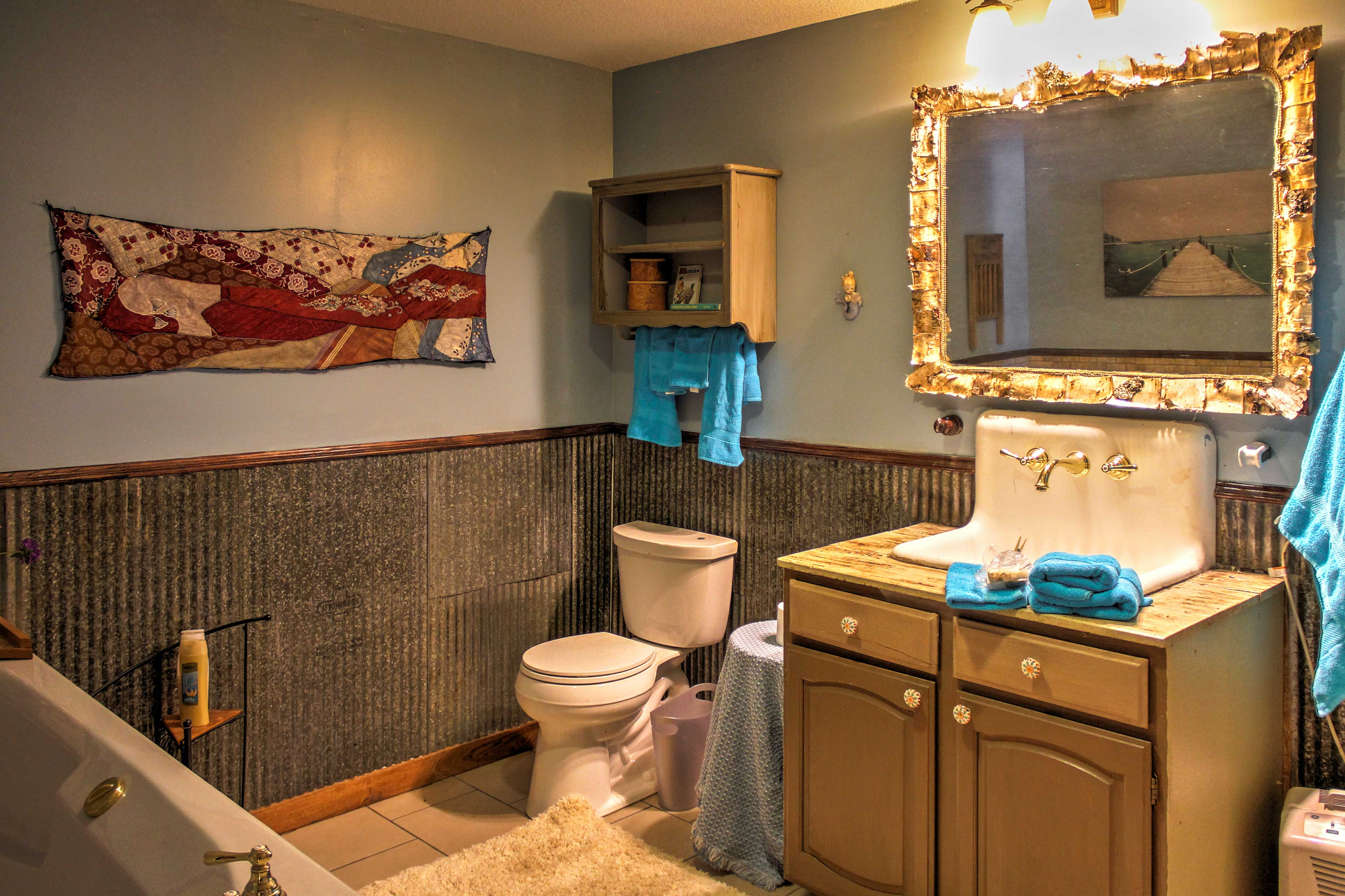 This full bathroom comes complete with a soaking tub and walk-in shower.