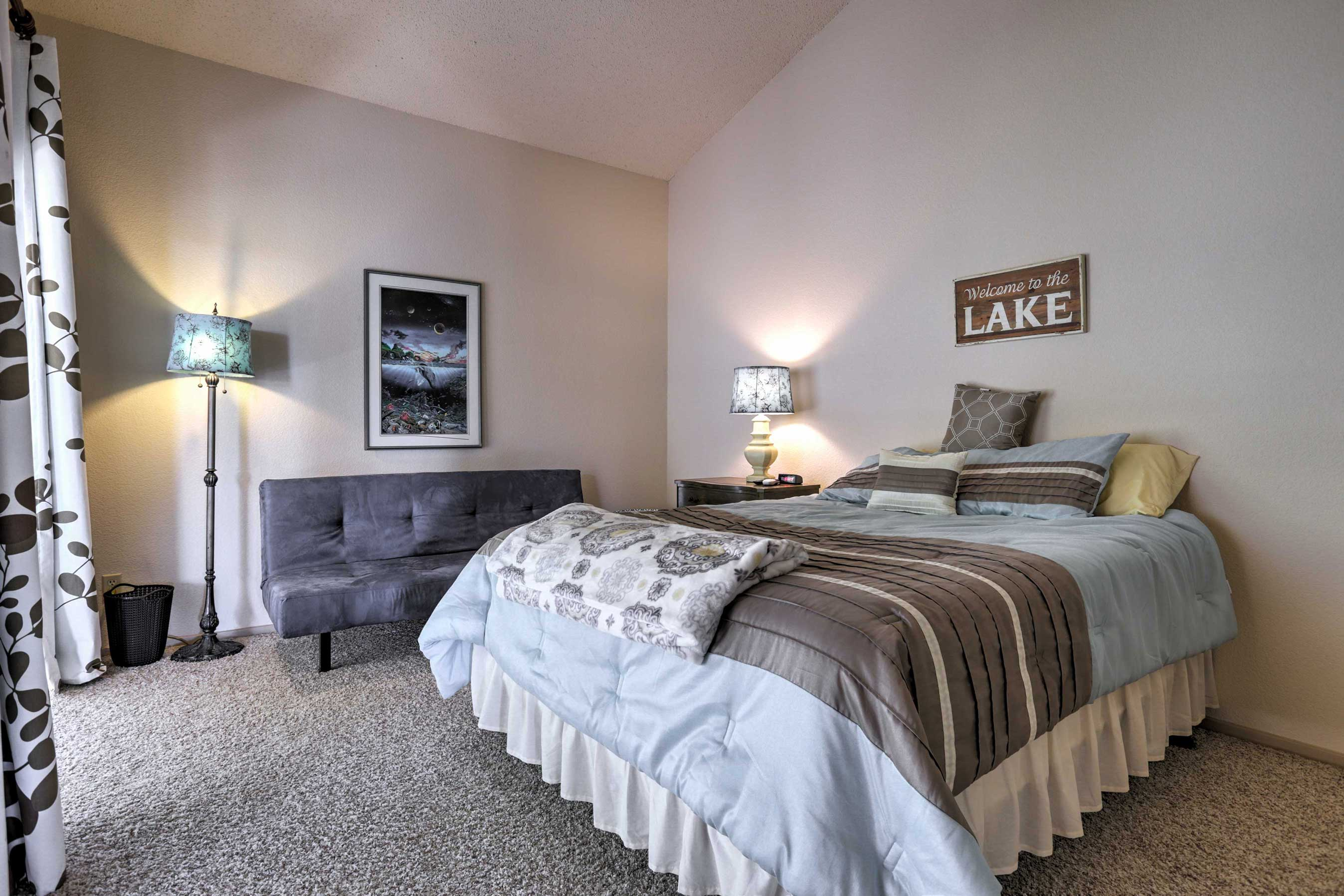 The master bedroom has a queen-sized bed and a futon.