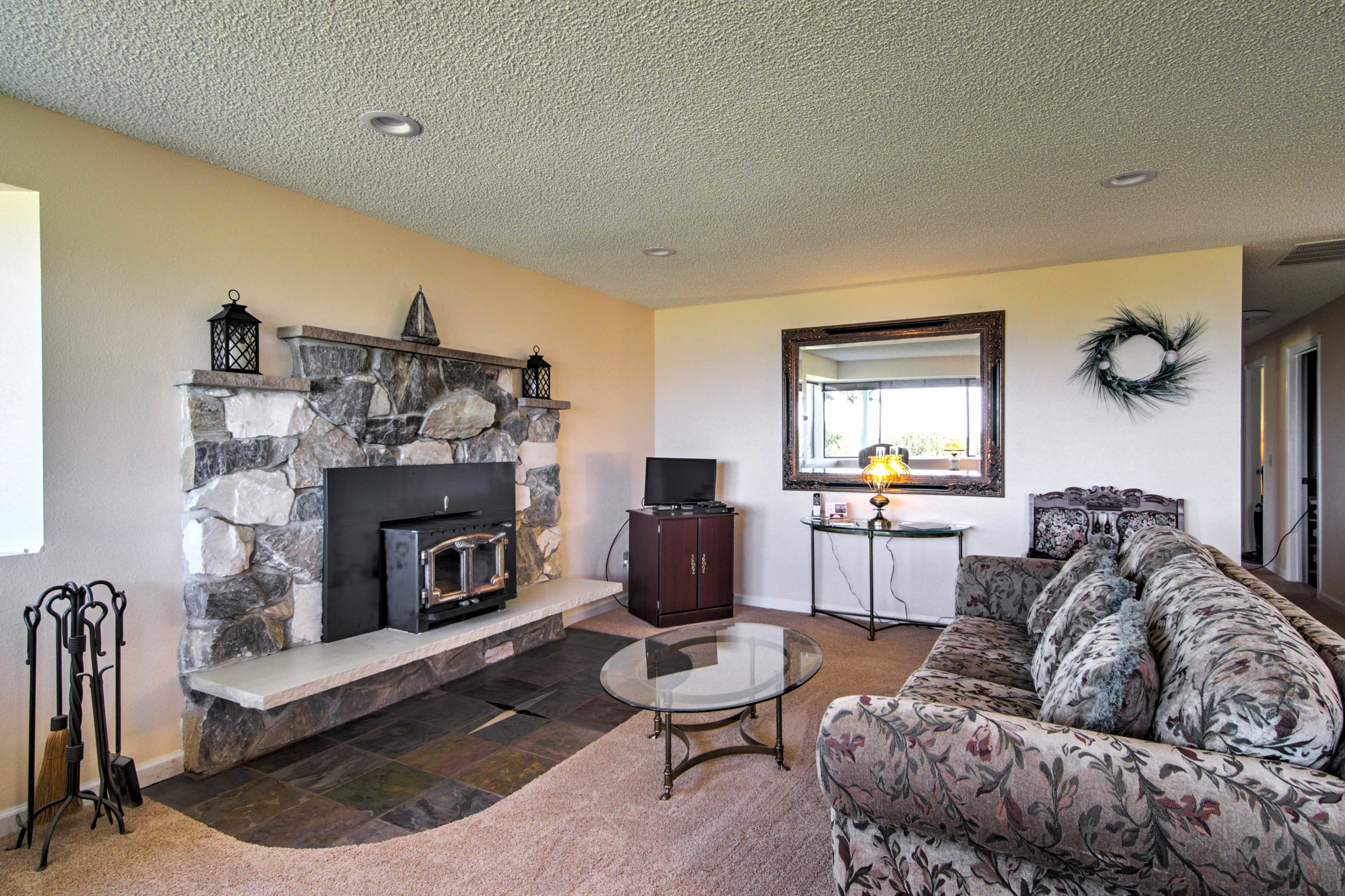 Unwind on the sofa while keeping warm next to the wood-burning stove.