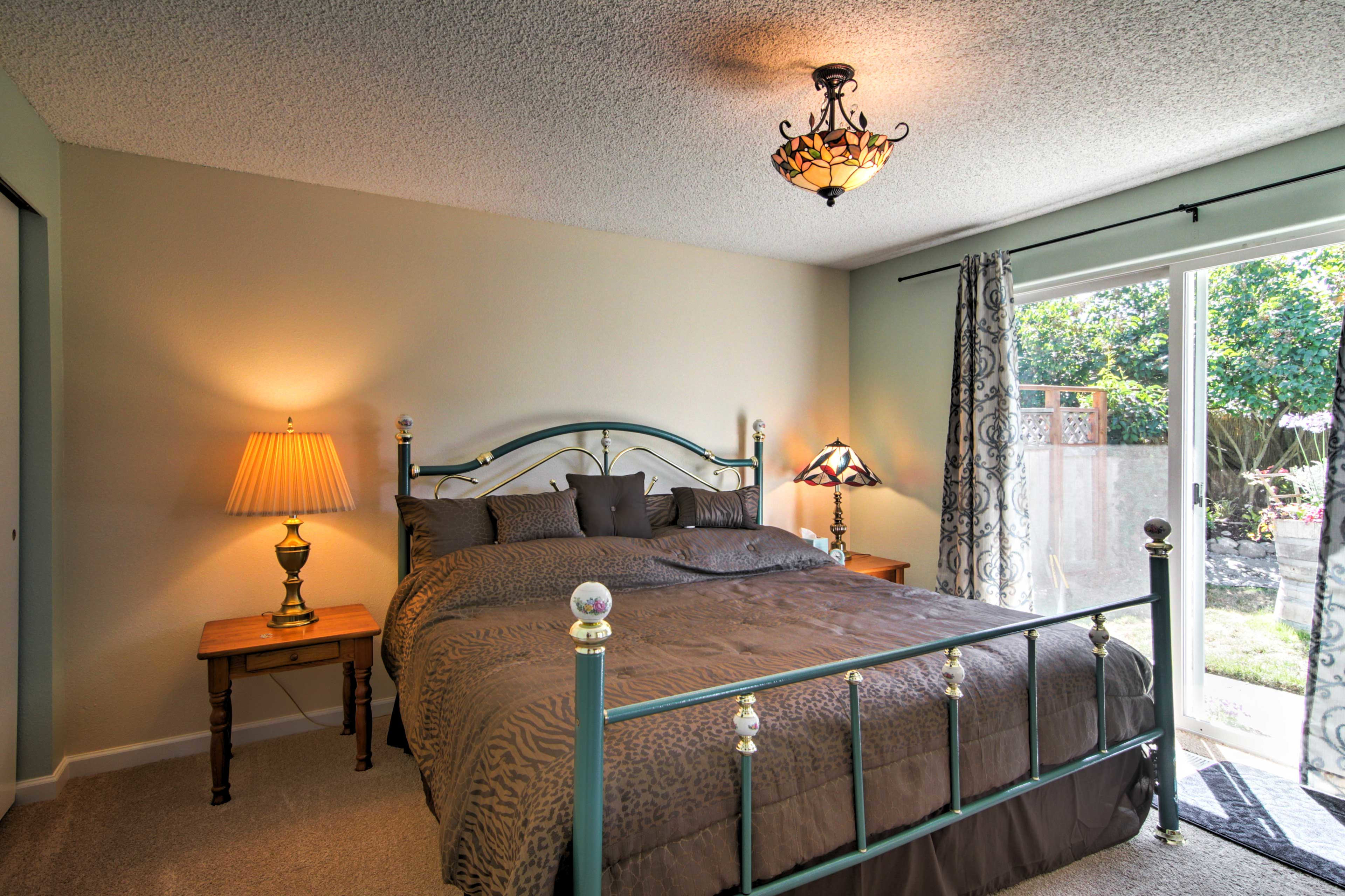 This master bedroom contains a king-sized bed and direct courtyard access.