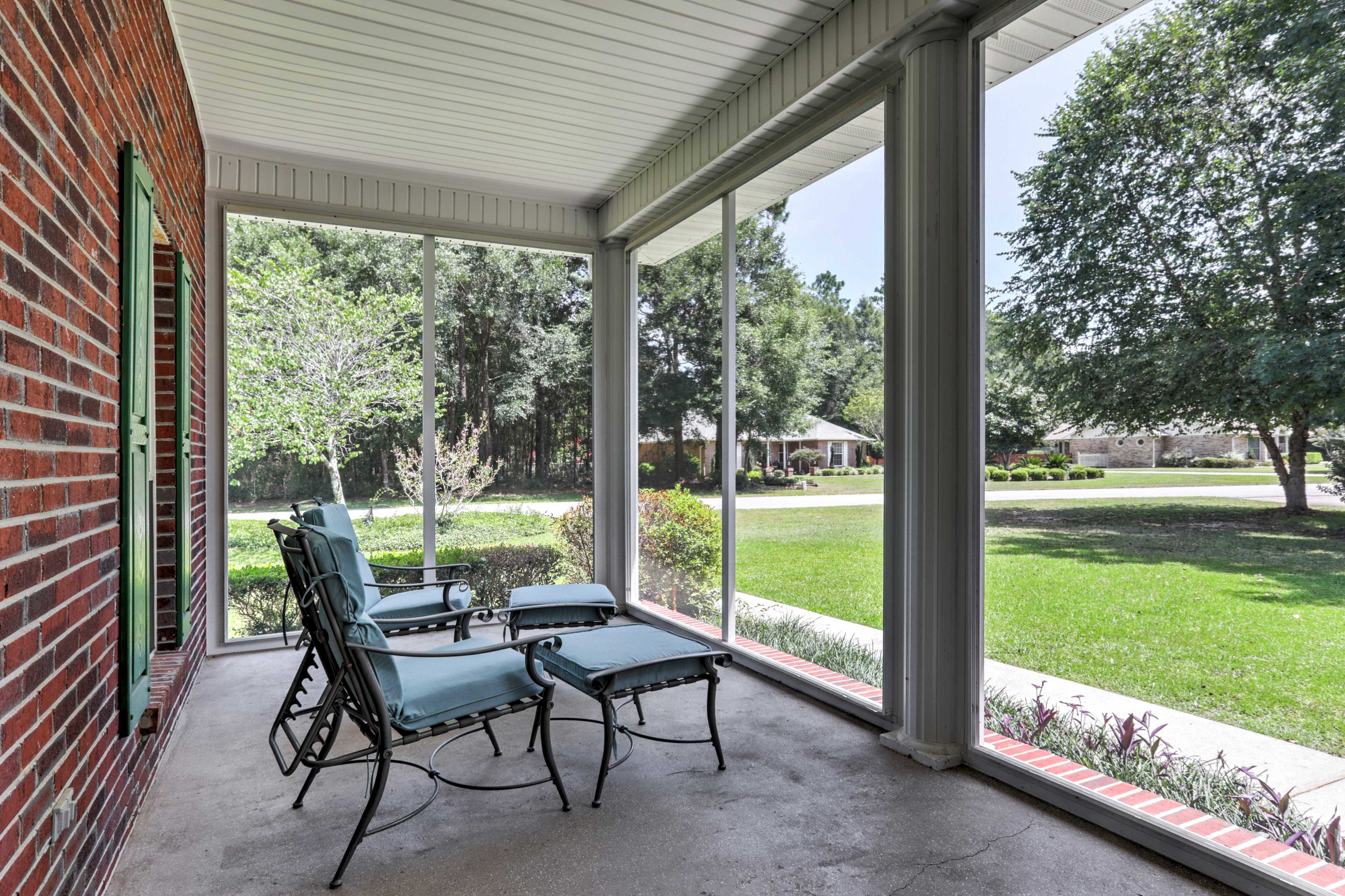 Sip your morning coffee outside on the screened-in porch.