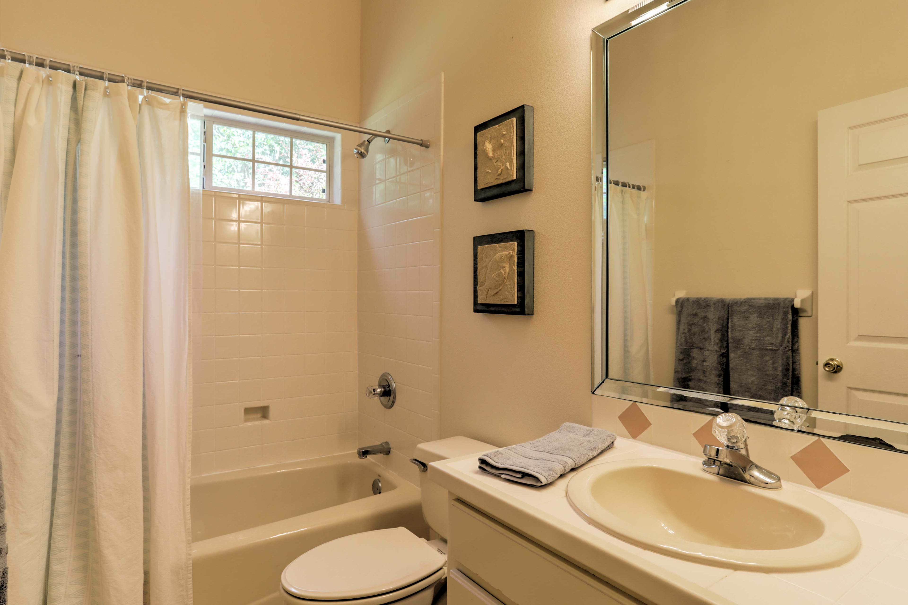 The 2nd full bathroom offers a single sink, large vanity, and tub/shower combo.