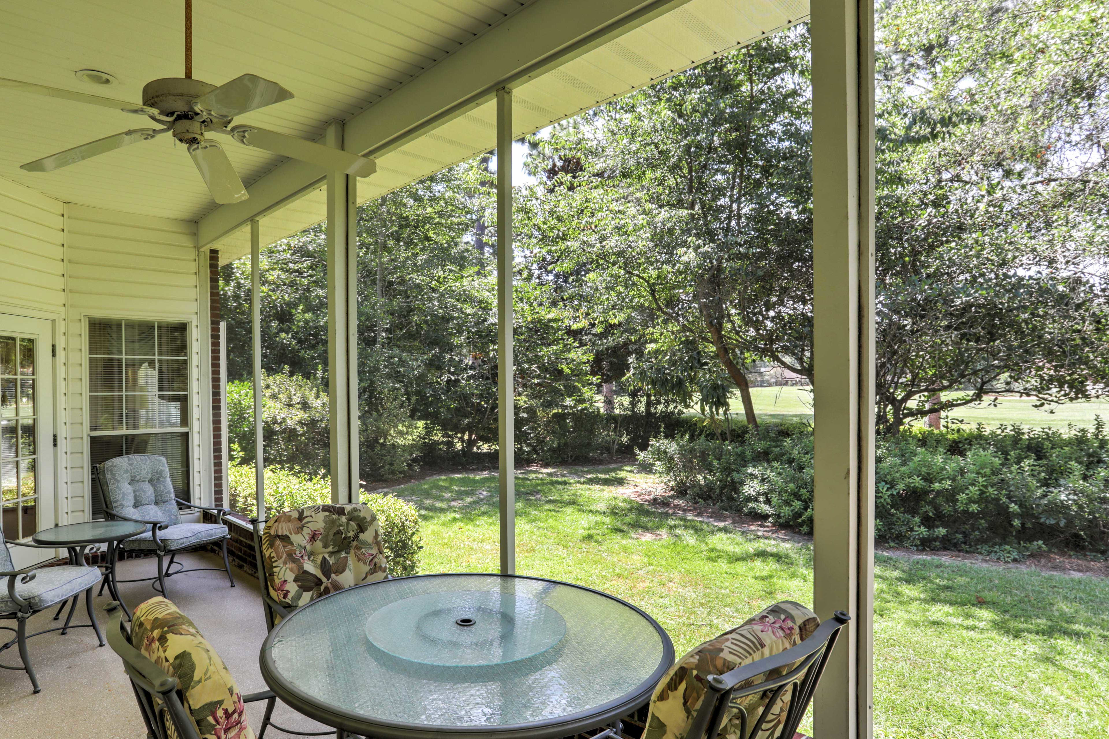 The screened-in porch is great for outdoor dining.