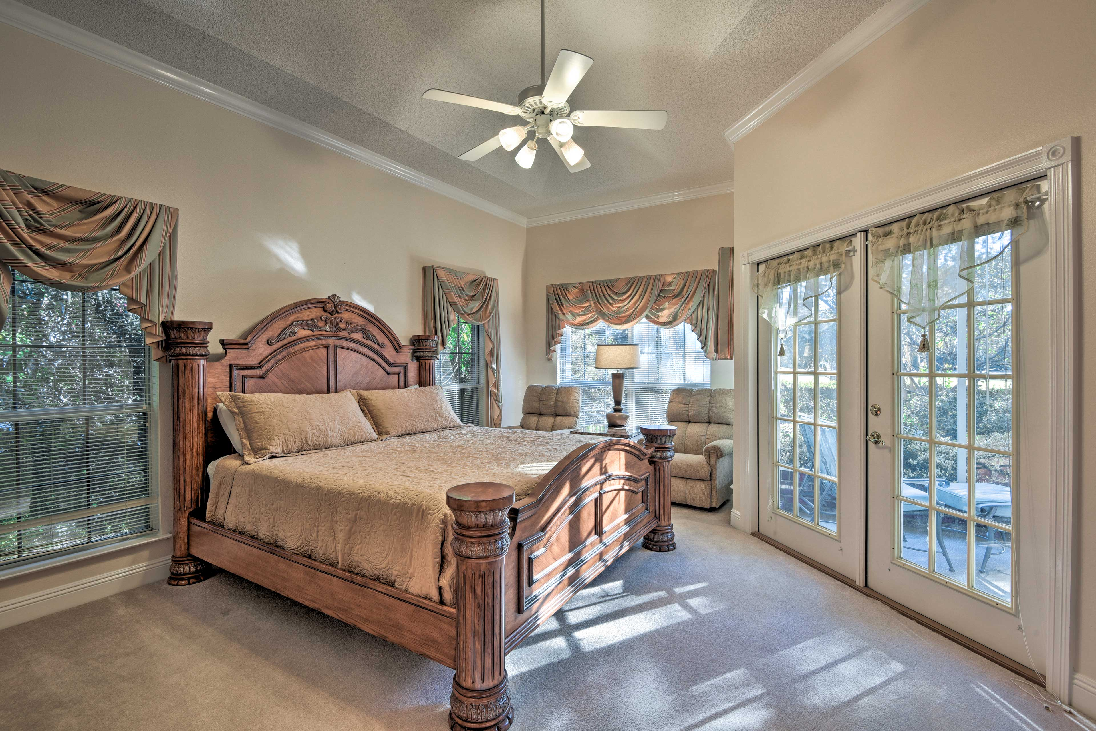 The master bedroom boasts a huge king bed.