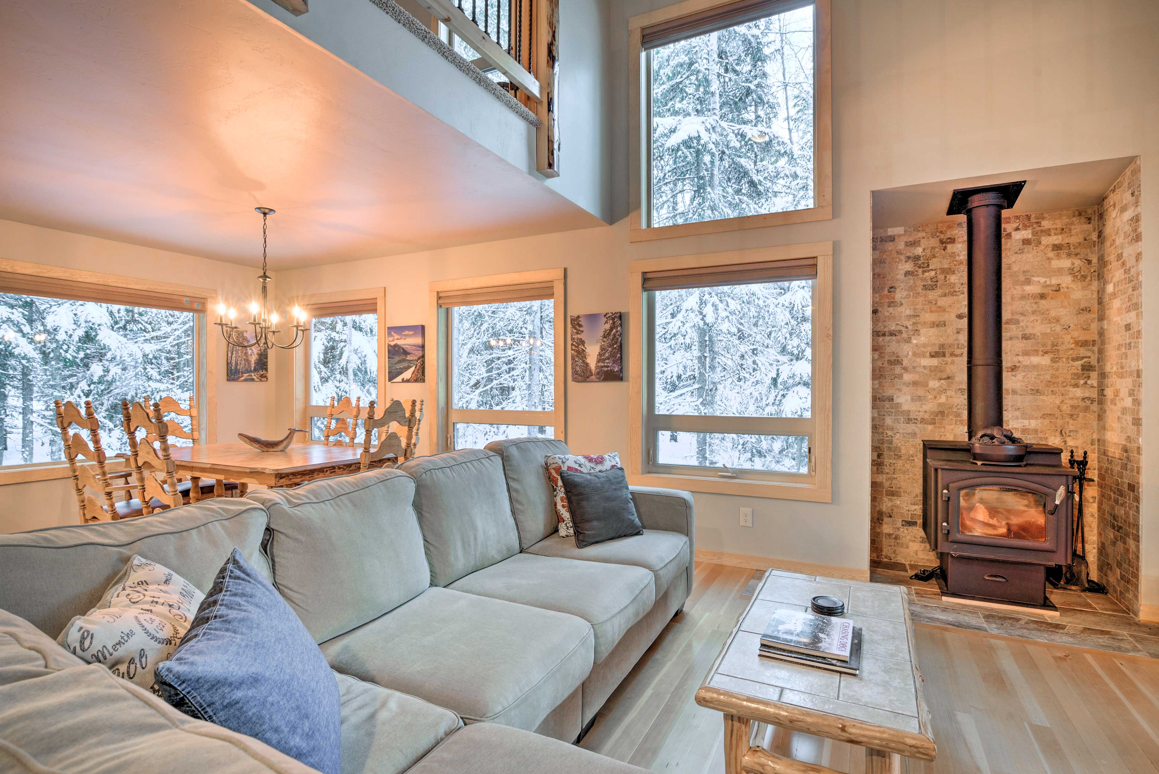 Windows let the outdoors in, showing off the spruce, hemlock and birch trees.