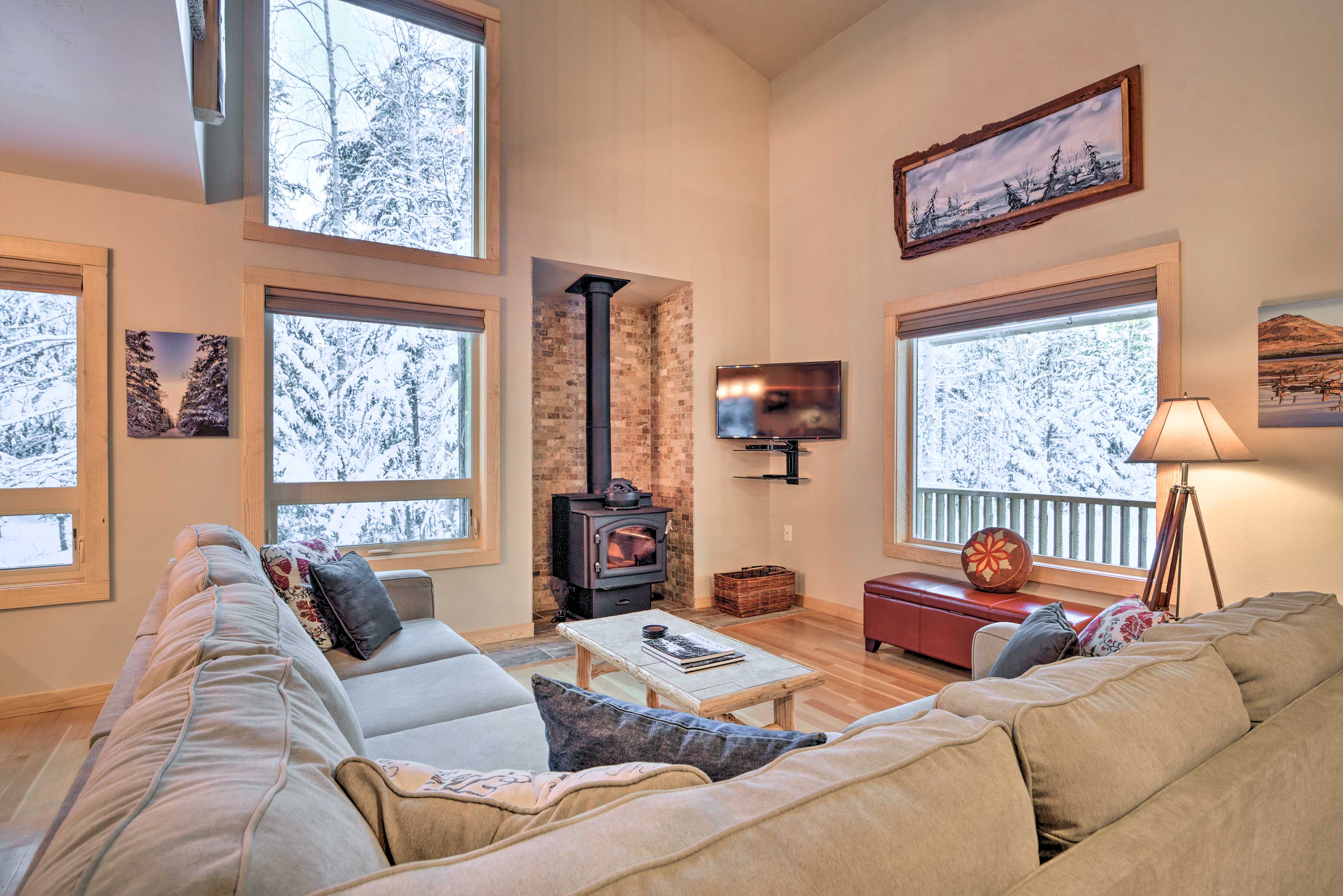 Step right into this true 'cabin in the woods' to experience the warmth of home.