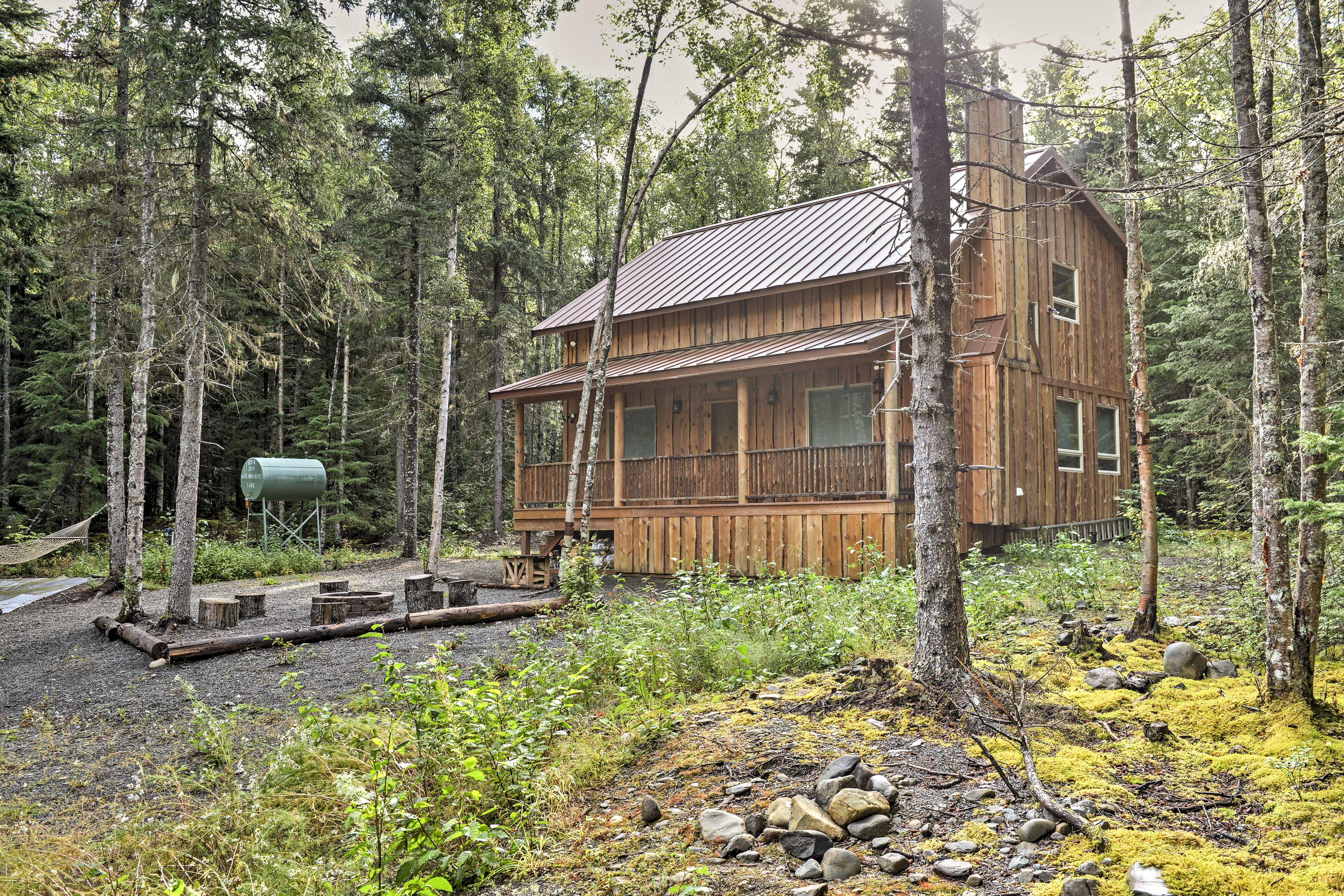 You'll love this cozy cabin in the woods!