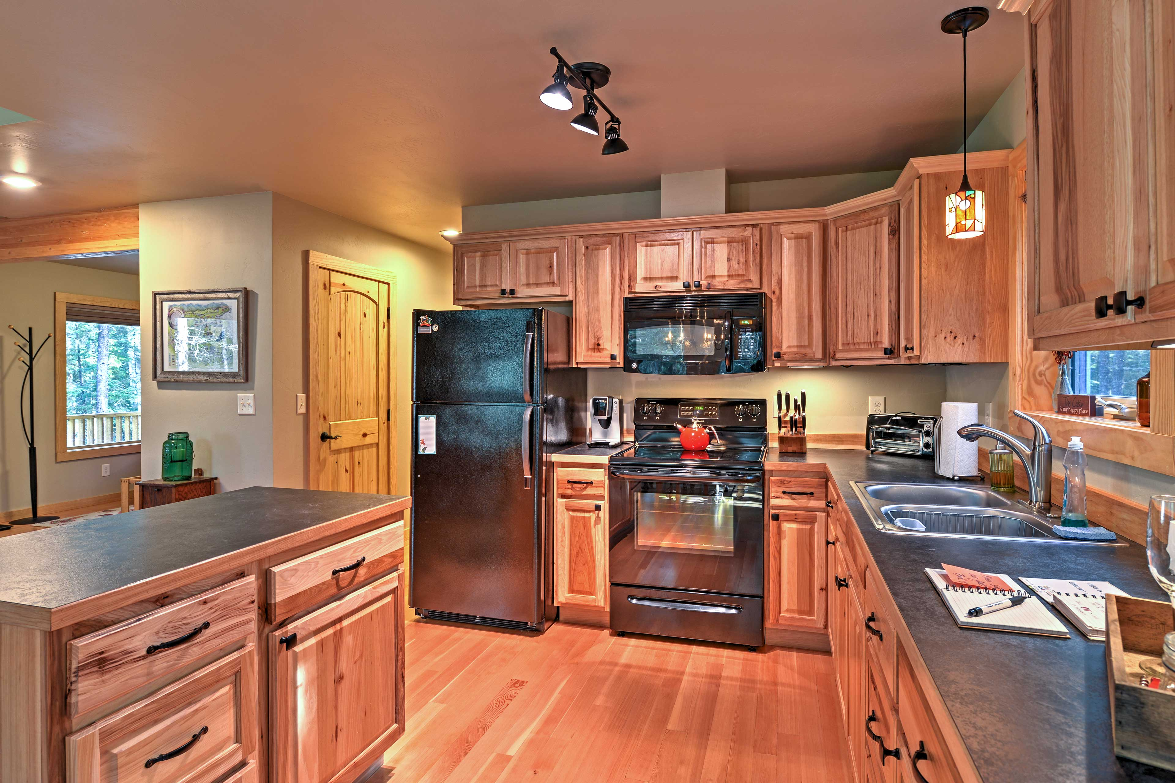 This classic, open kitchen features wood cabinets and ample counter space.