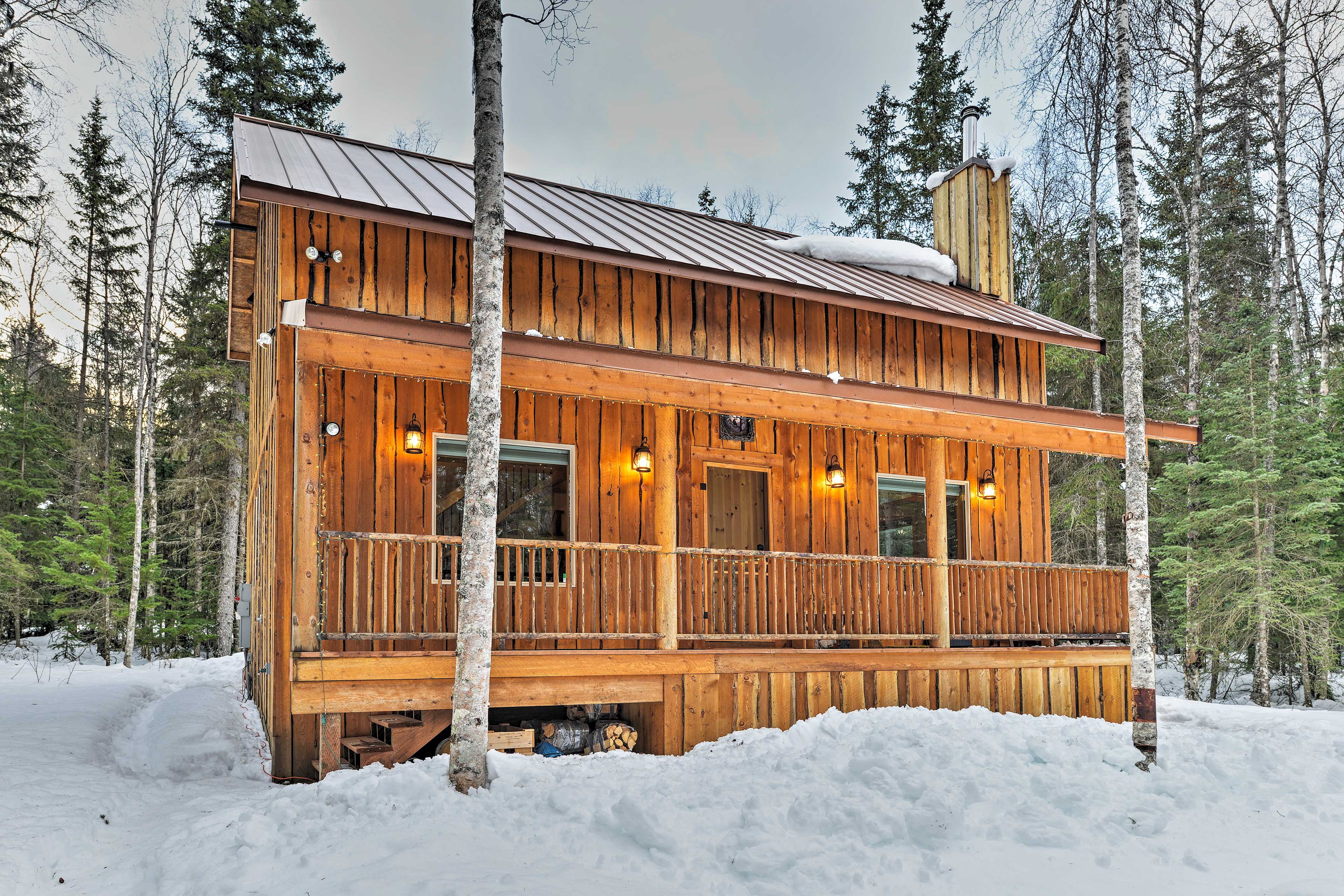 When snow falls in Alaska, the cabin sits in a winter wonderland.