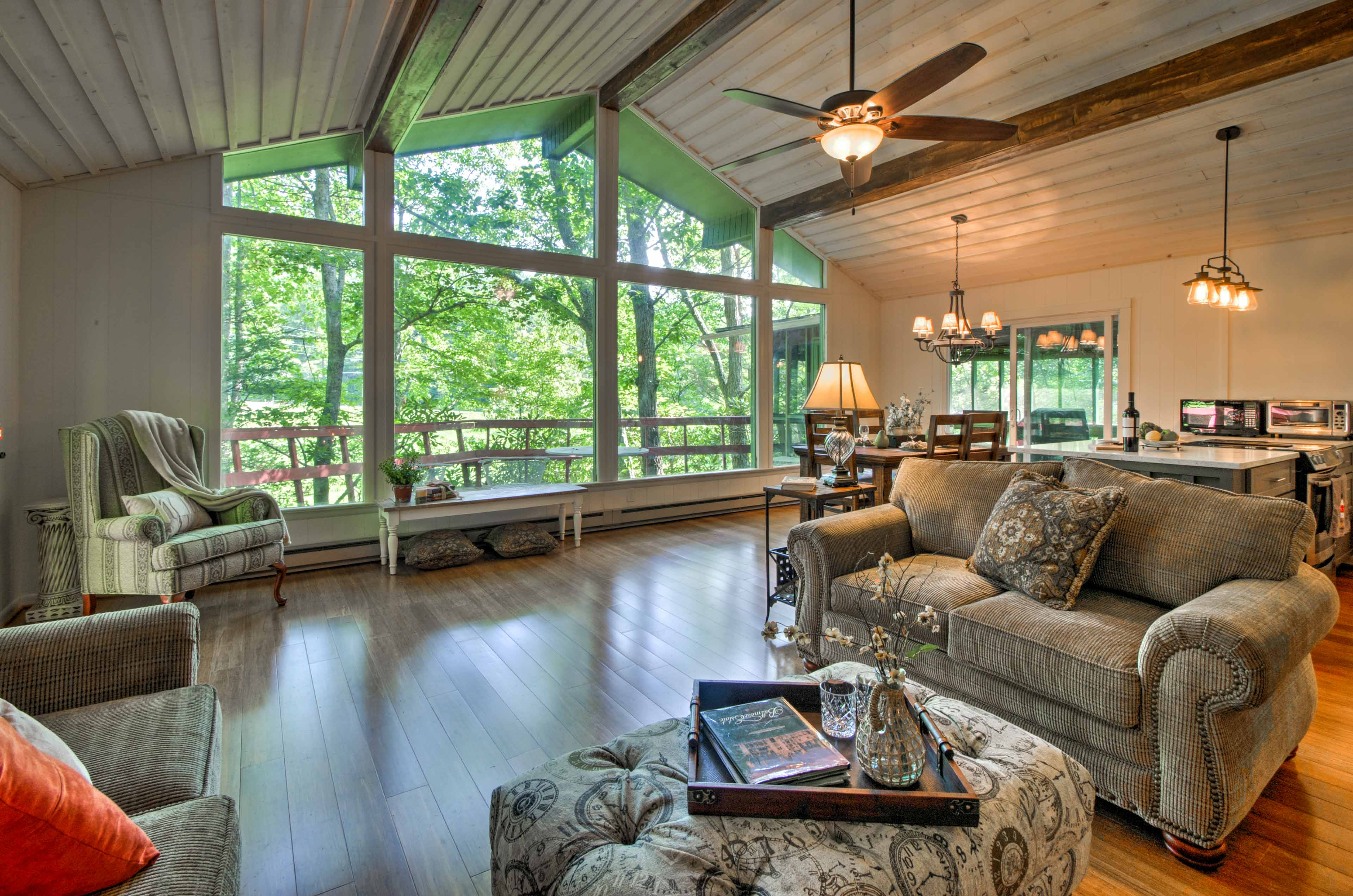 Enjoy serene views of the dense forest from the floor-to-ceiling windows during your stay at this 3-bedroom, 2-bathroom vacation rental house in Fairview.