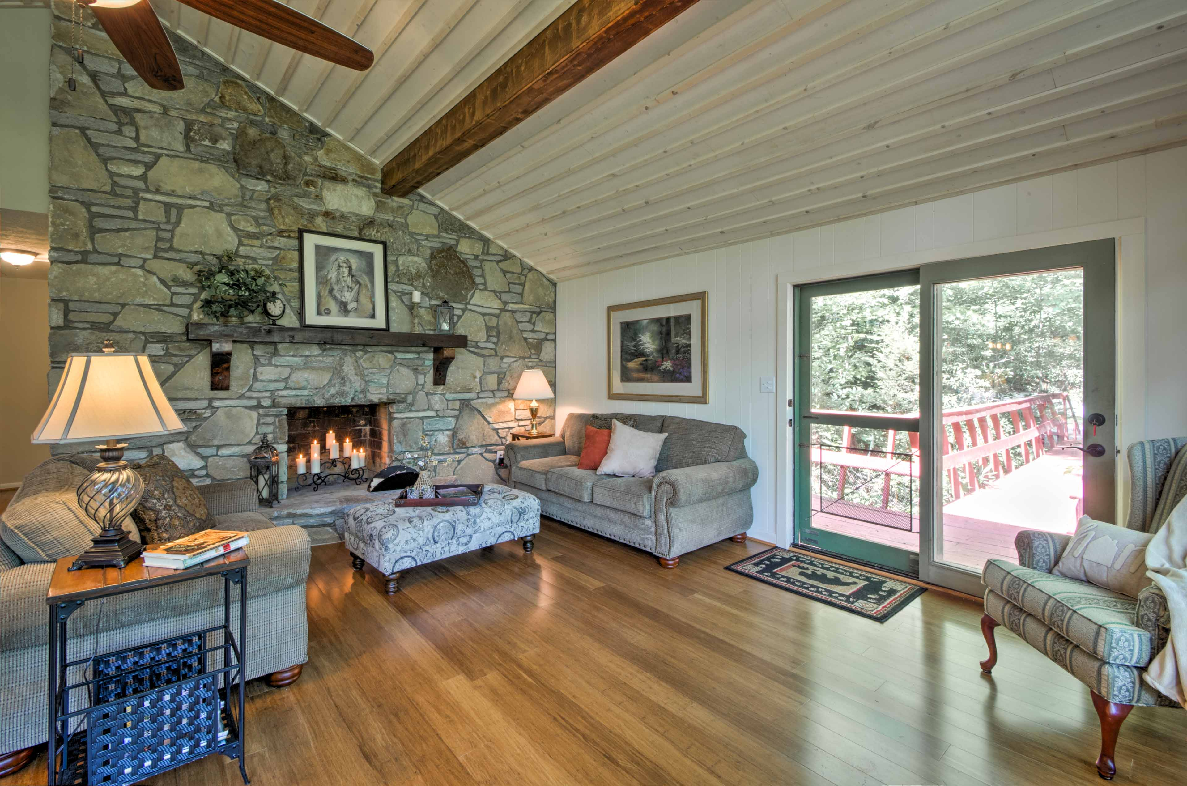 Step out to the deck through the glass door in the living room.