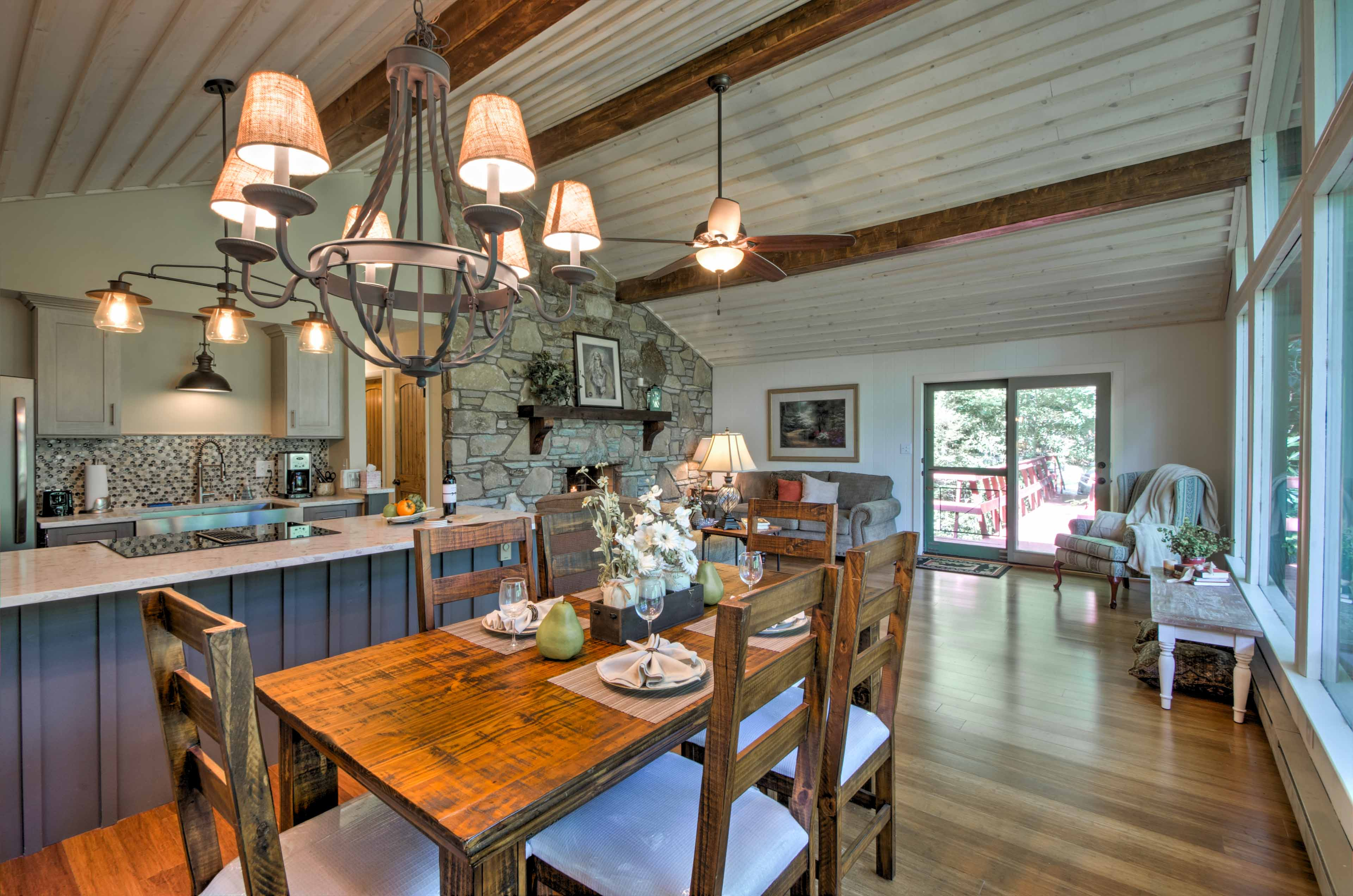 The home features an open floor plan and cathedral ceilings with exposed wood beams.