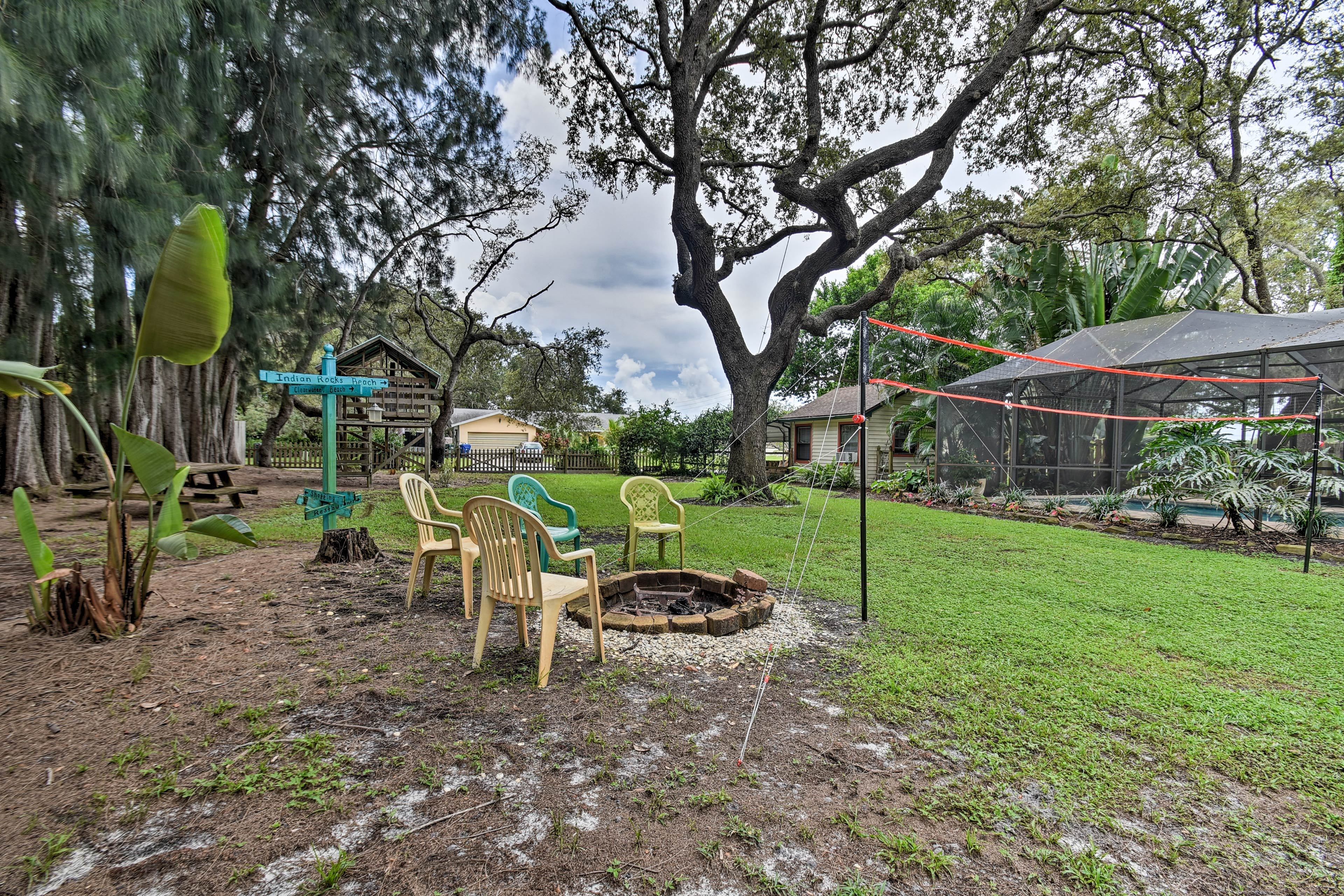 Venture out to the half-acre backyard with trees, a fire pit, and a tree house!