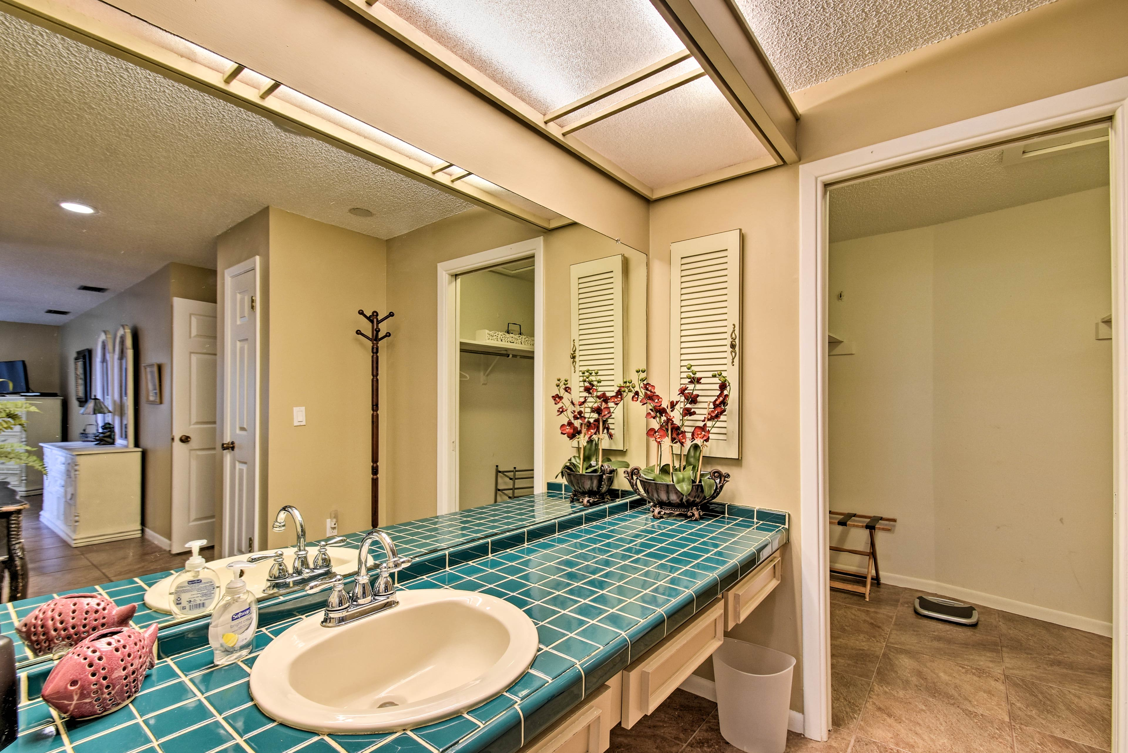 The master en-suite includes a large single vanity and a shower/tub combo.