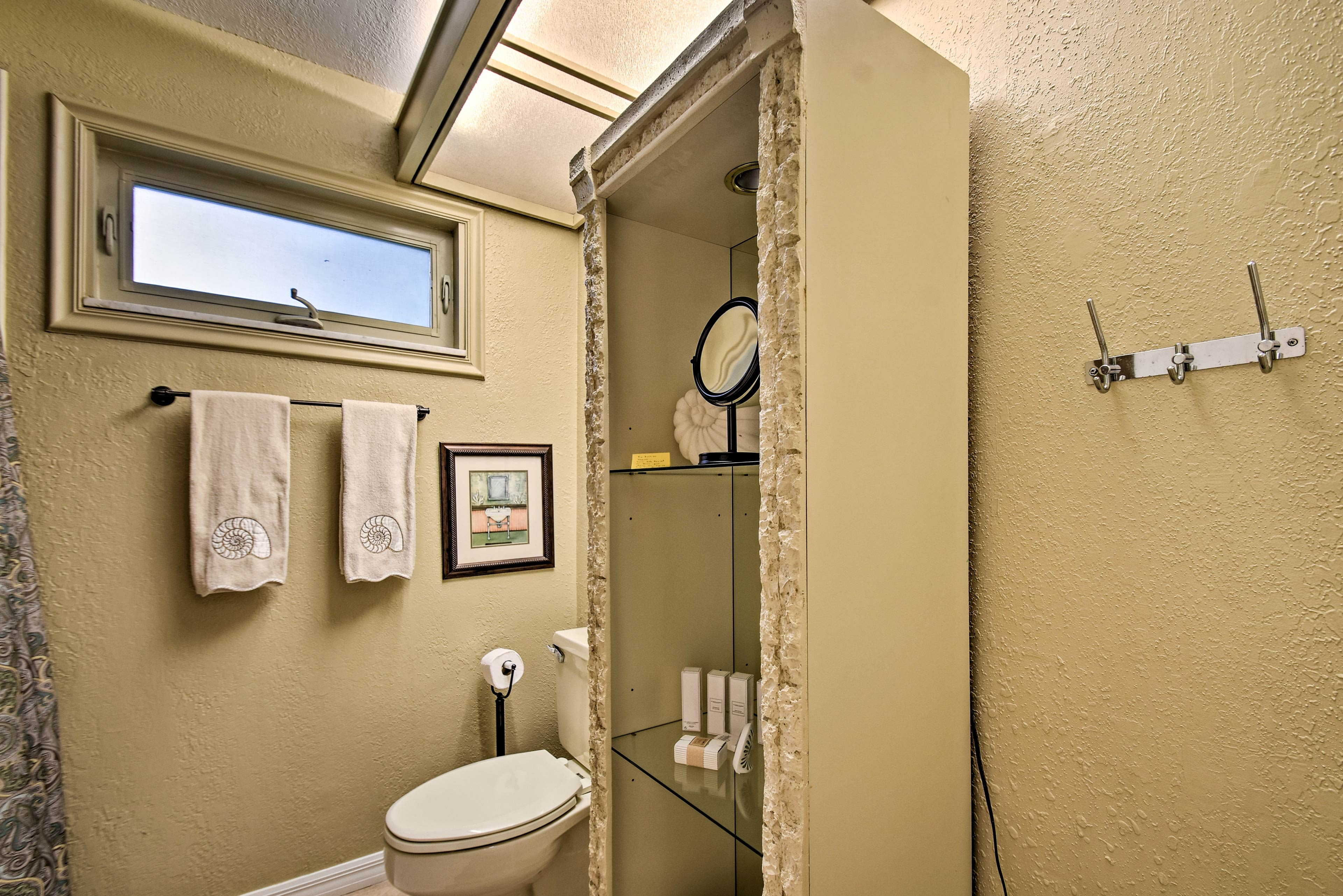The chic bathroom features provided toiletries.