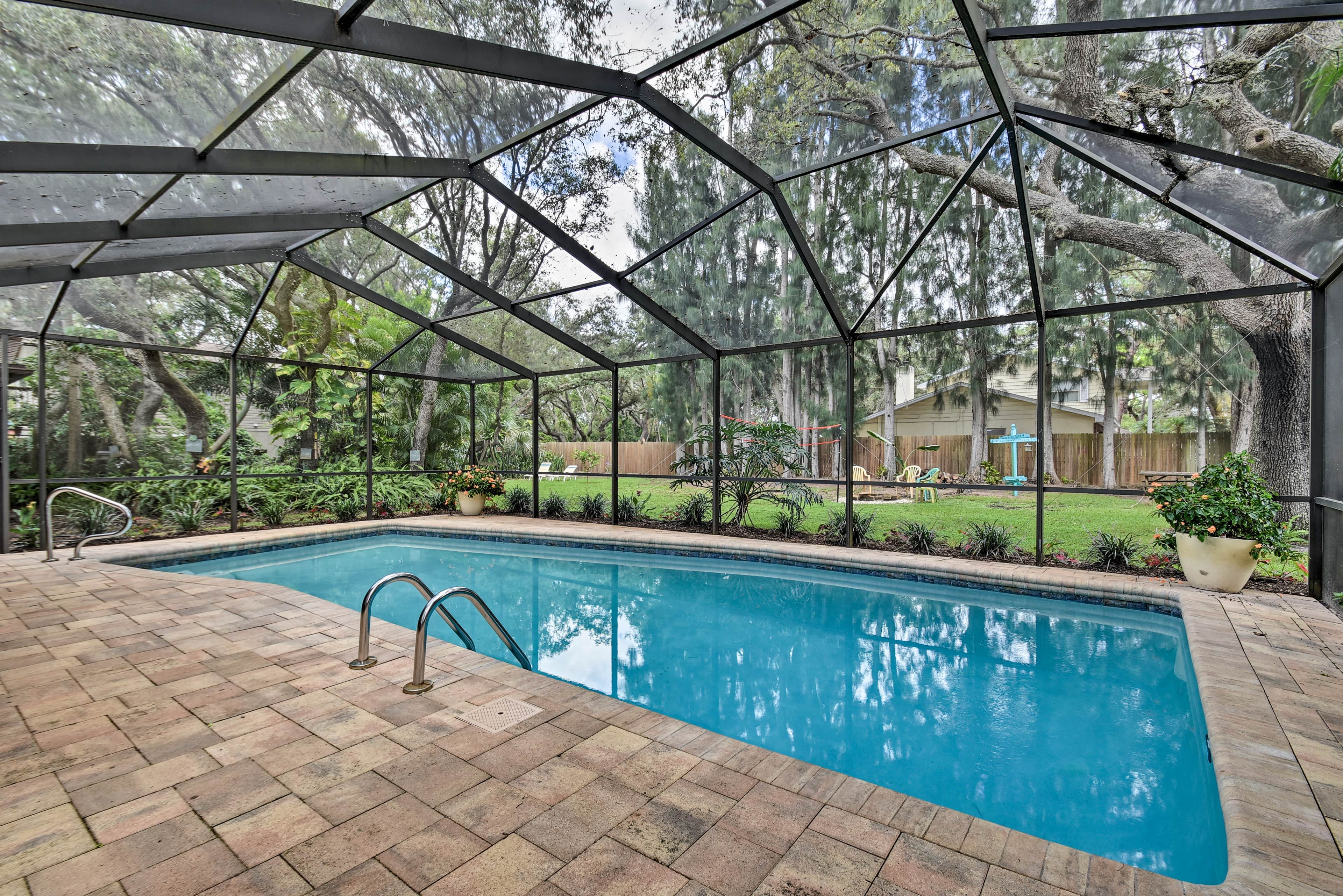 Let the kids take a dip in the large pool covered by a lanai.