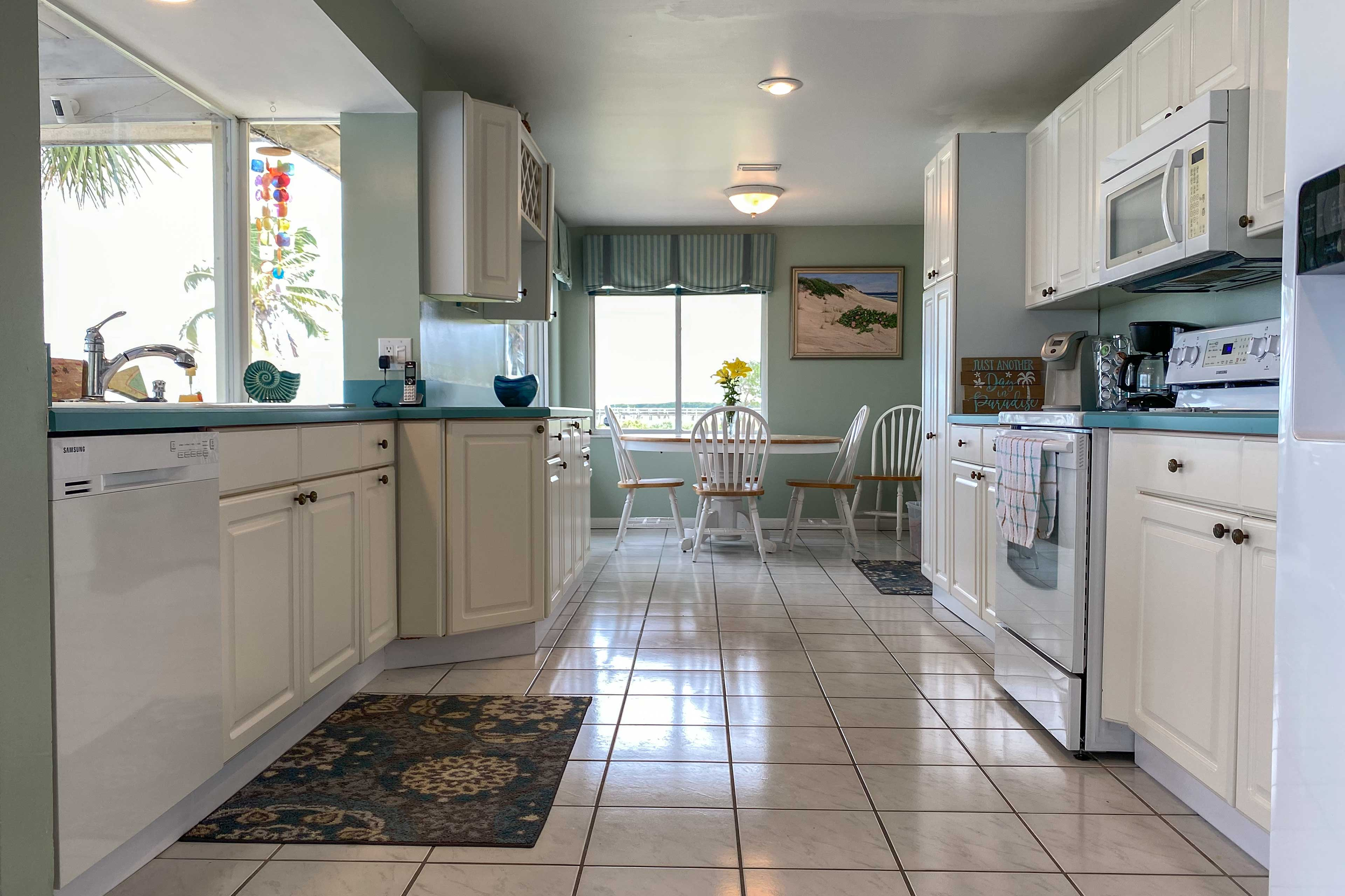 Guests love the white cabinets that line the entire kitchen.