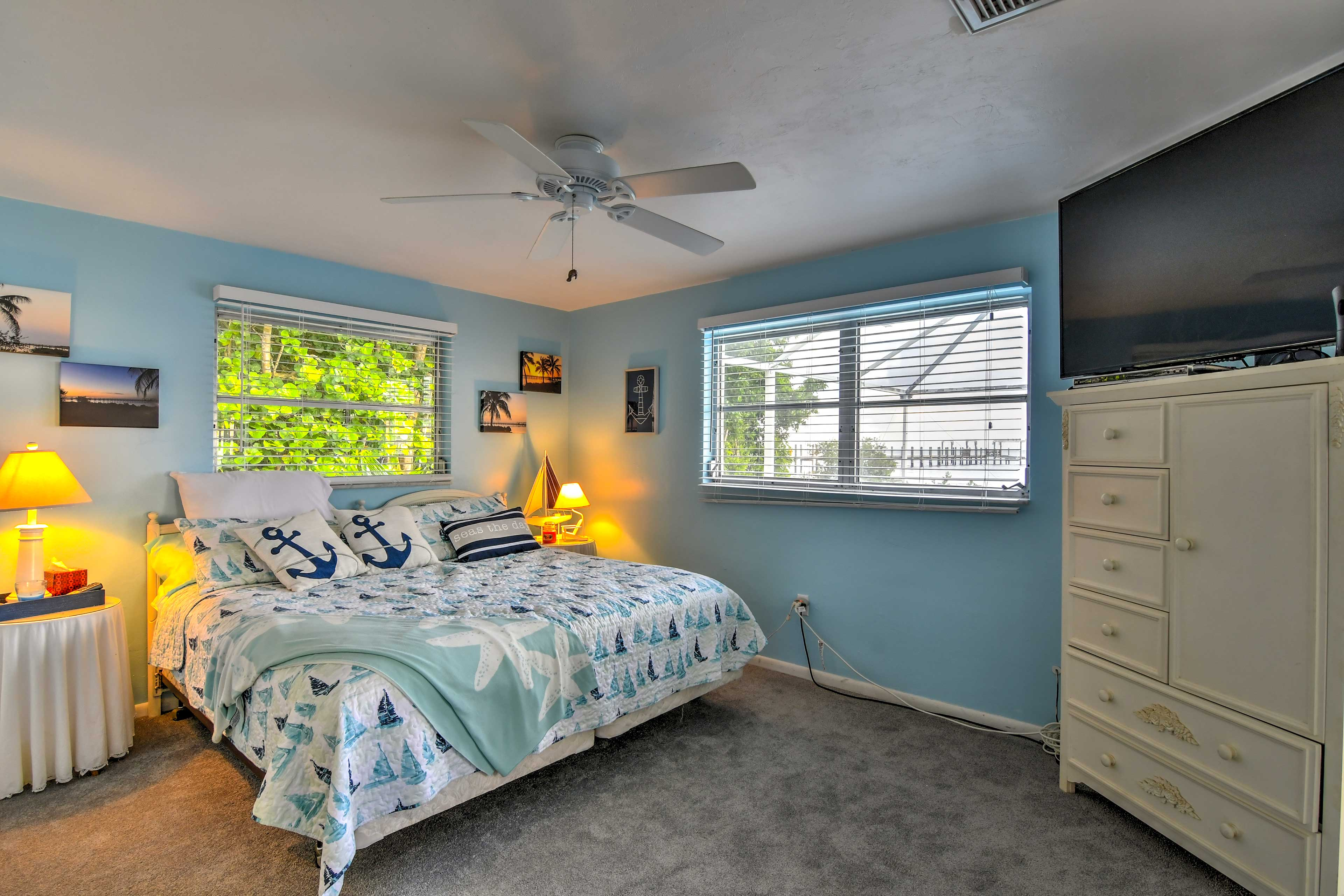 The master bedroom offers a cozy king mattress and nautical accents.