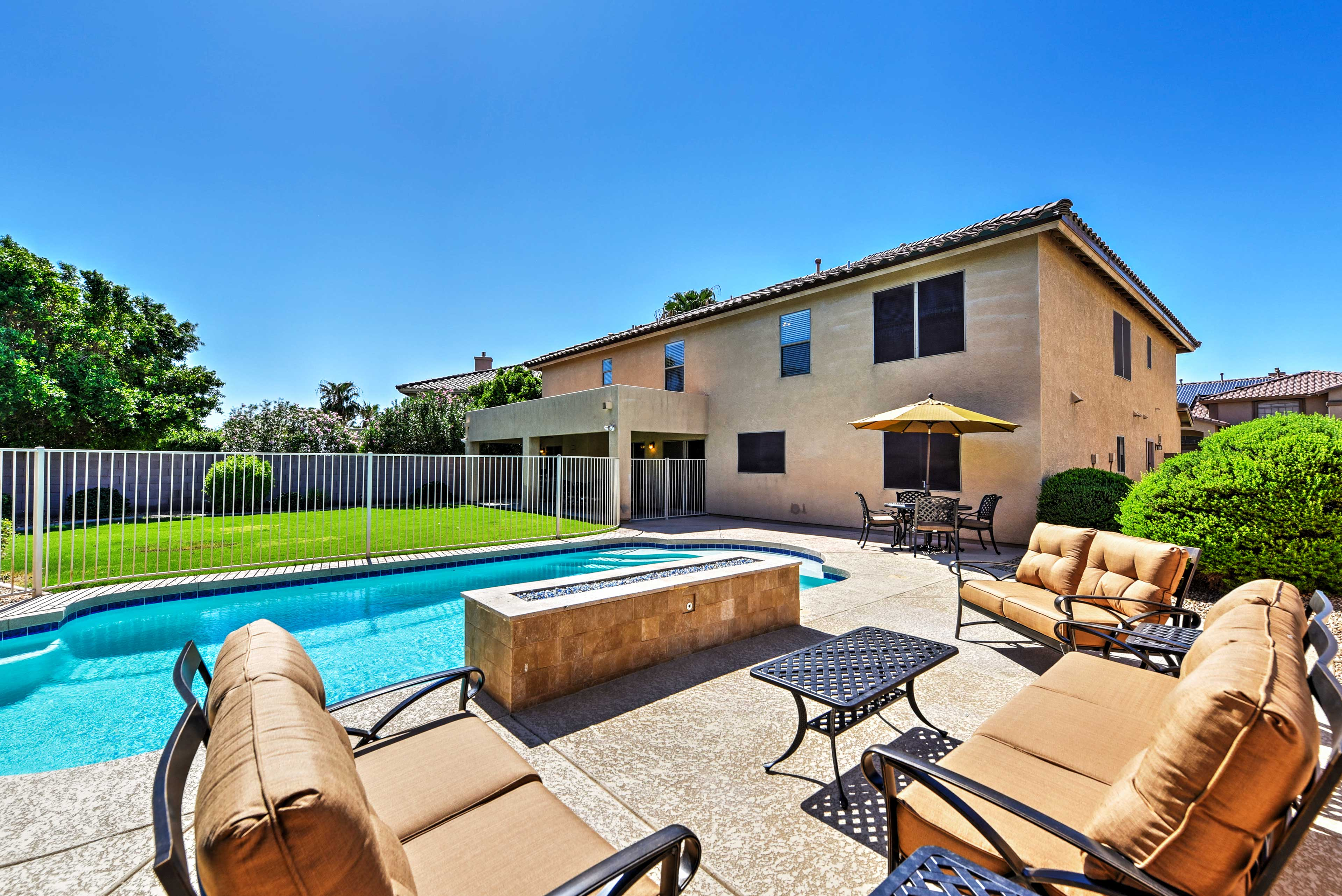 Lounge by the private pool while staying at this 5-bed vacation rental home!