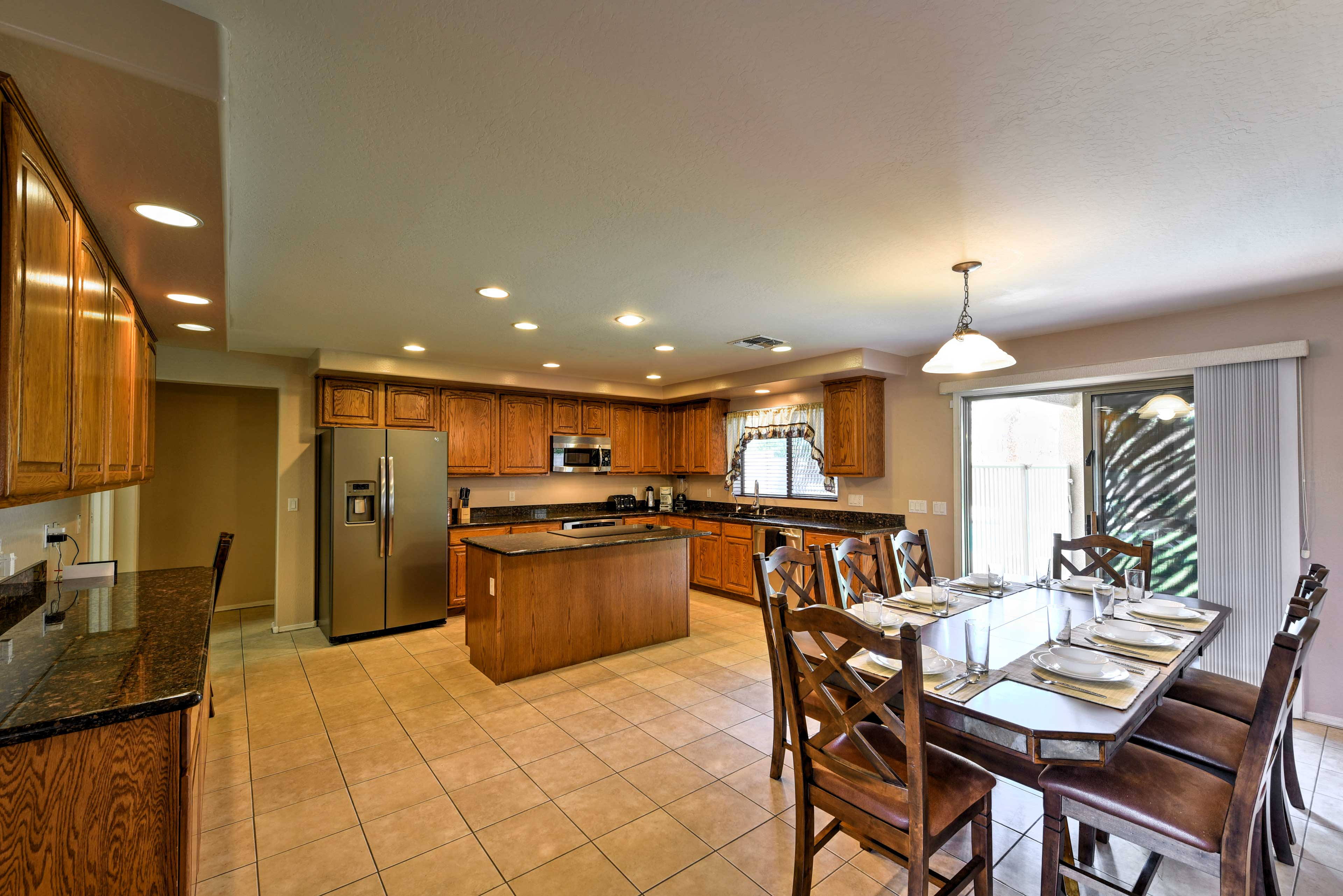 Kitchen with ample counter space and a dining table to serve home-cooked meals!