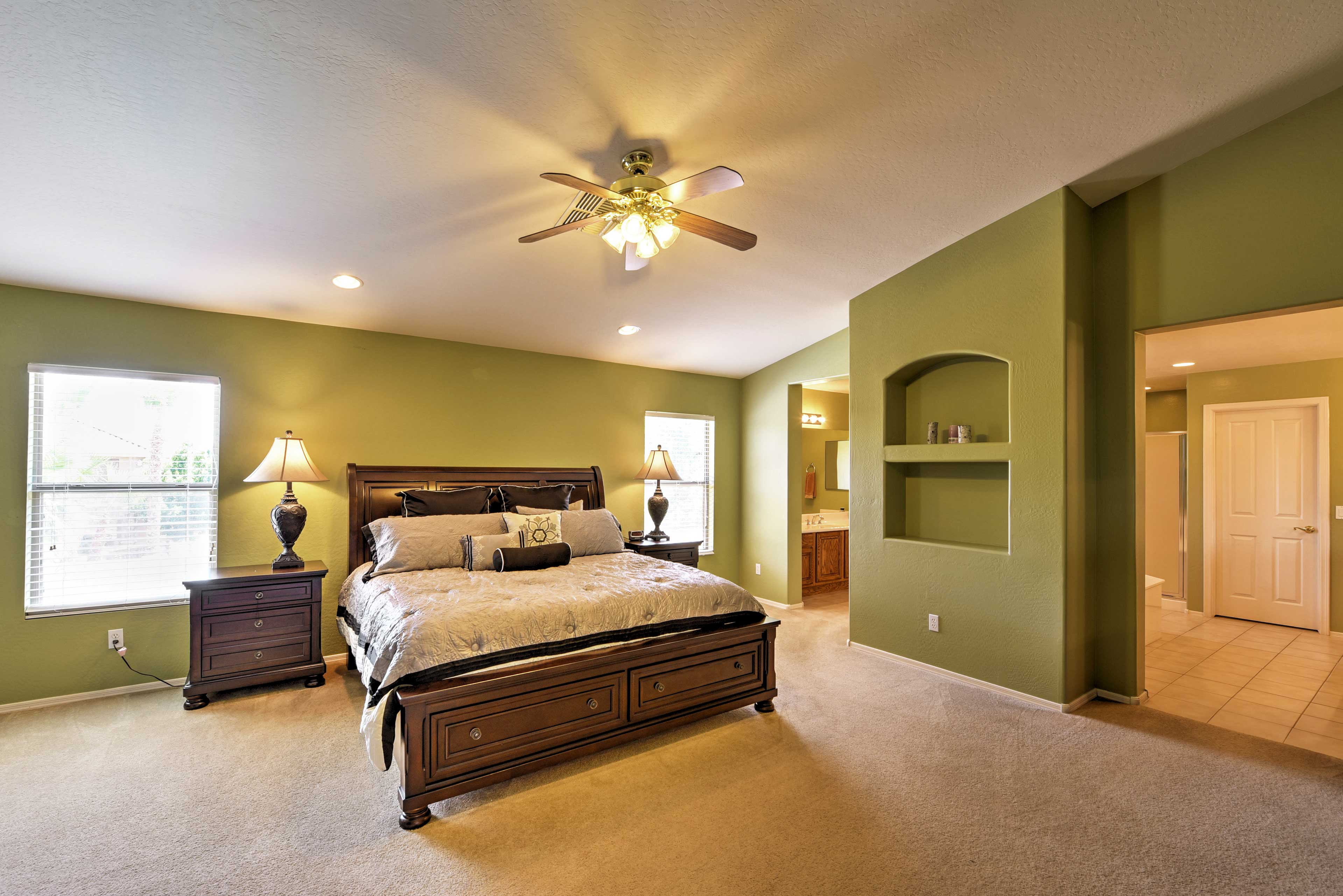 The master bedroom has a king bed, sure to delight the heads of the household.