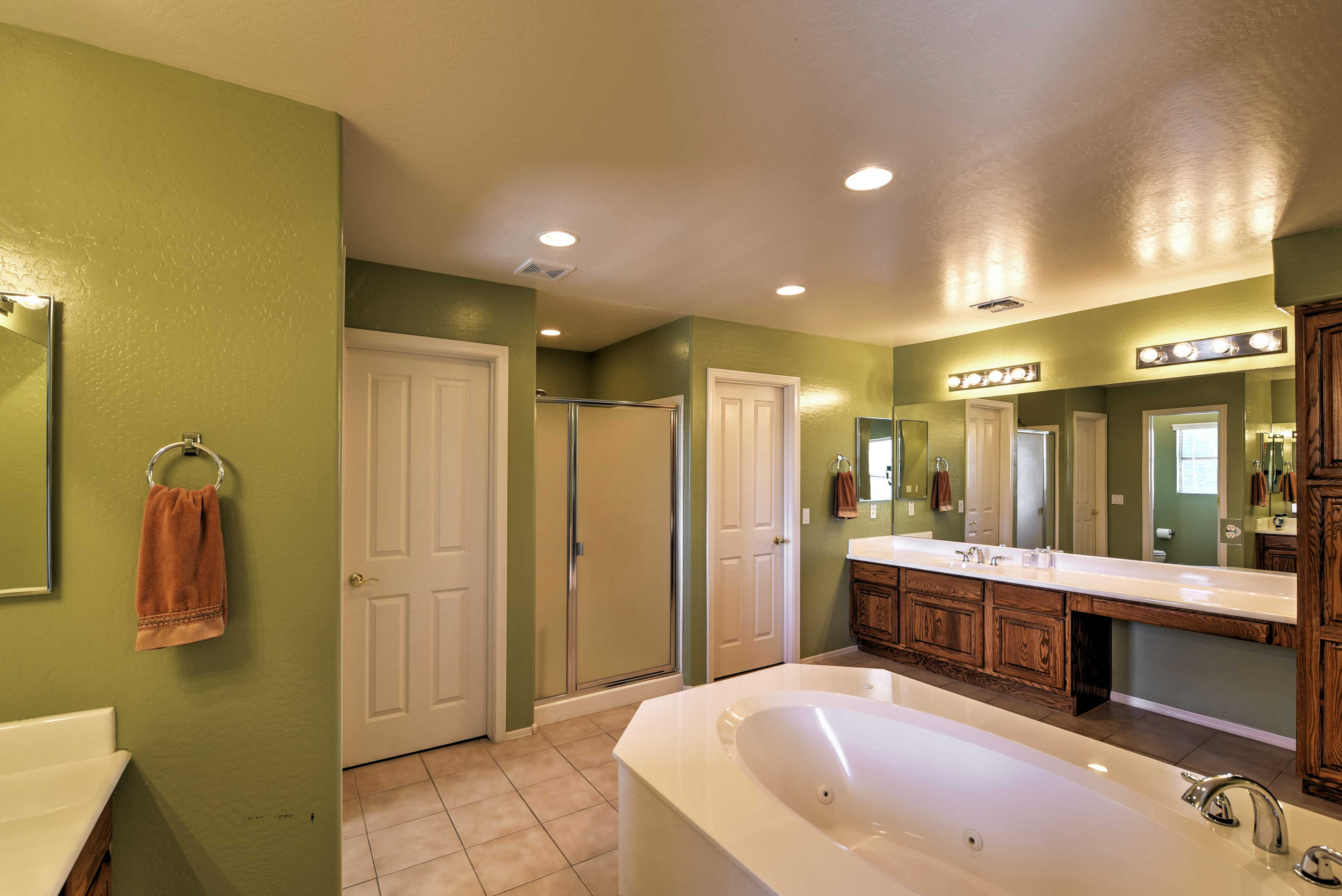 The master bedroom features a large en suite bathroom w/ tub & separate shower.