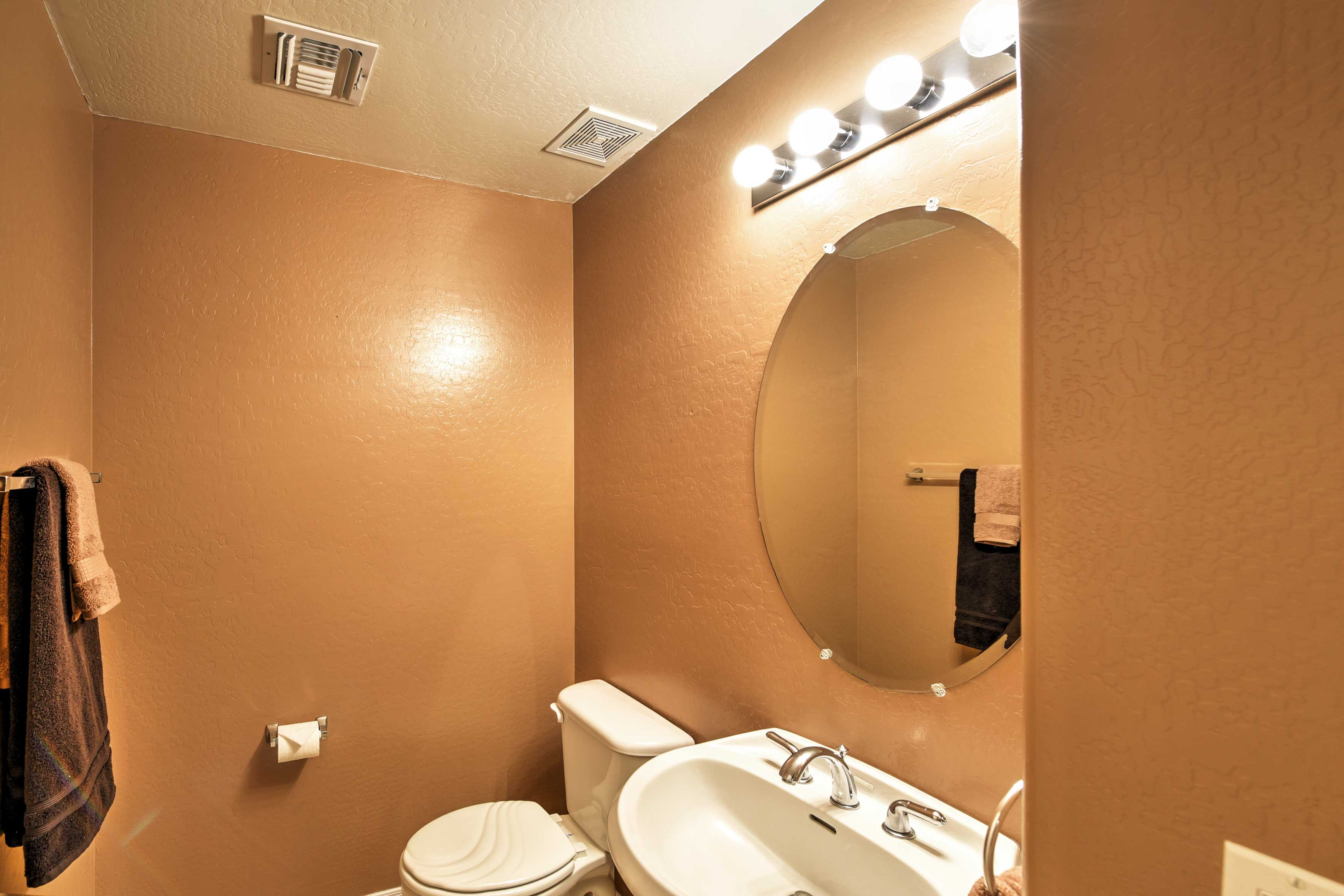 This half bathroom will come in handy for all guests!