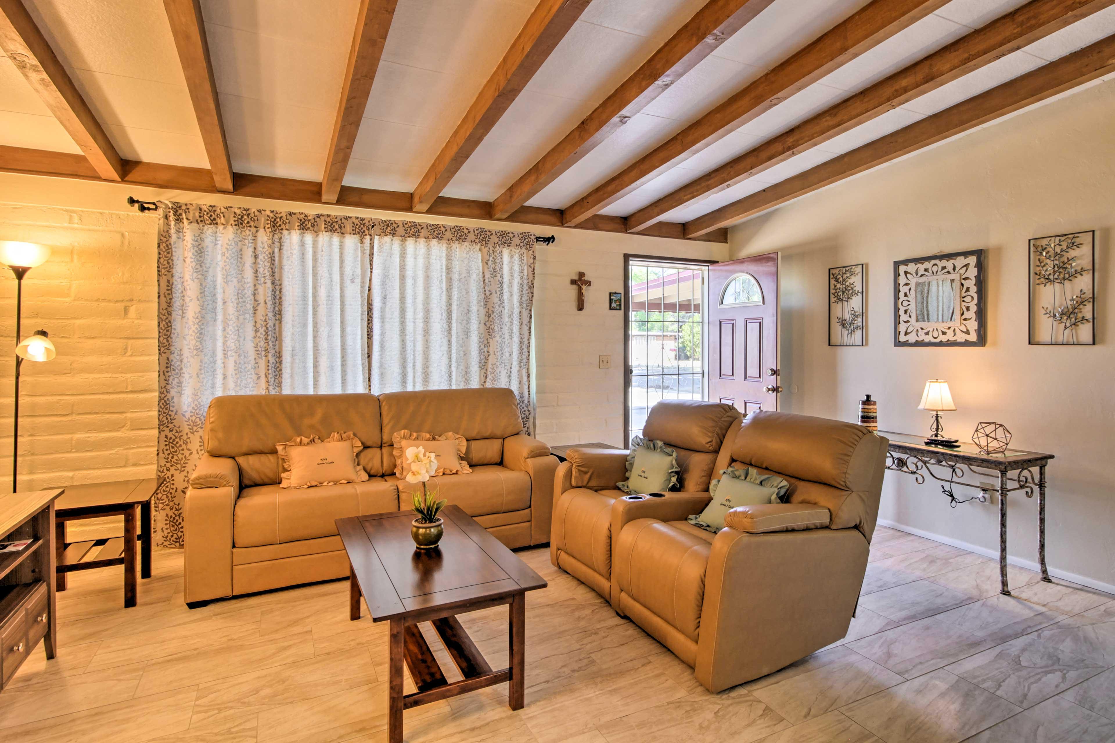Unwind on the comfortable living room furnishings.