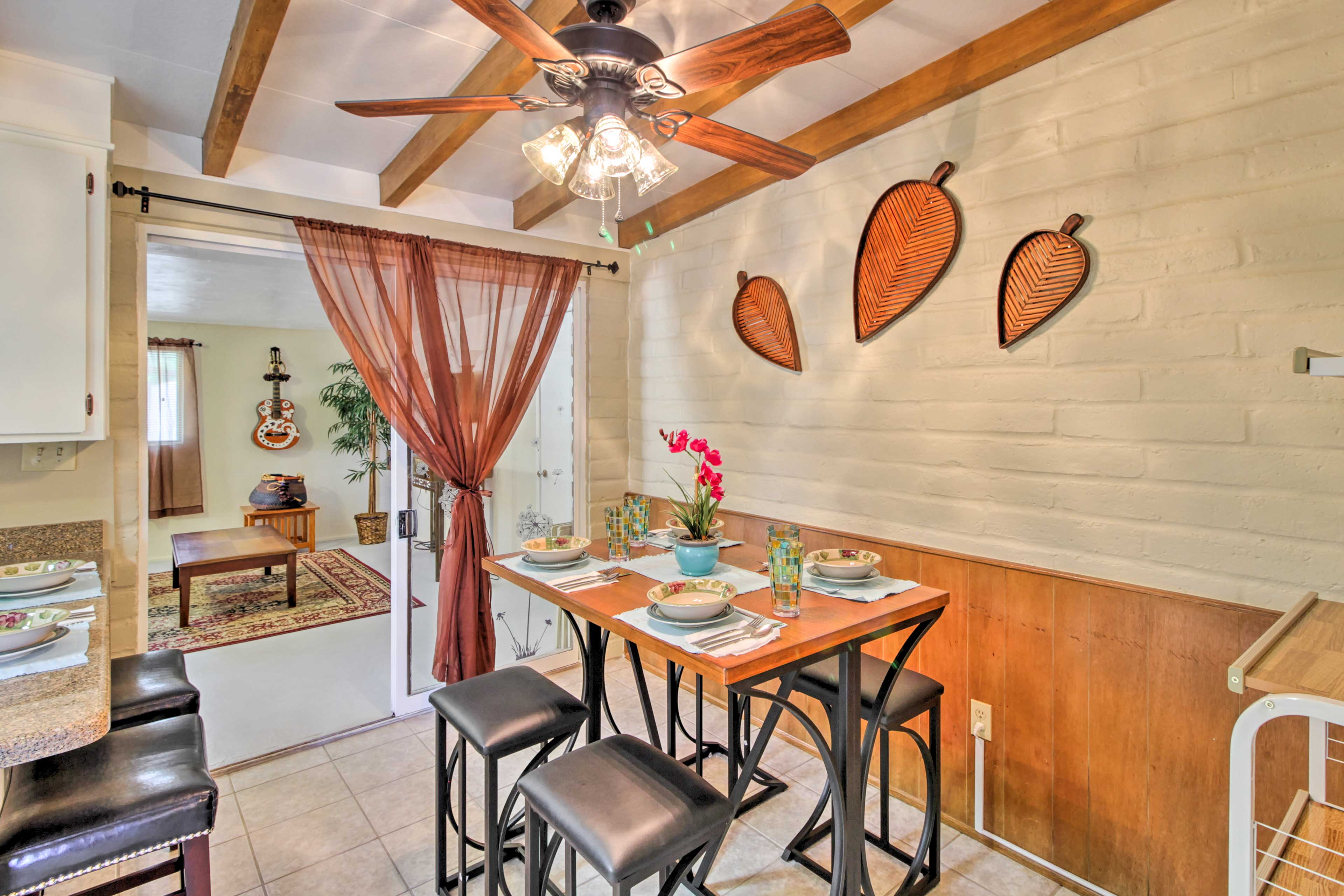 Savor family meals around the 4-person dining table.