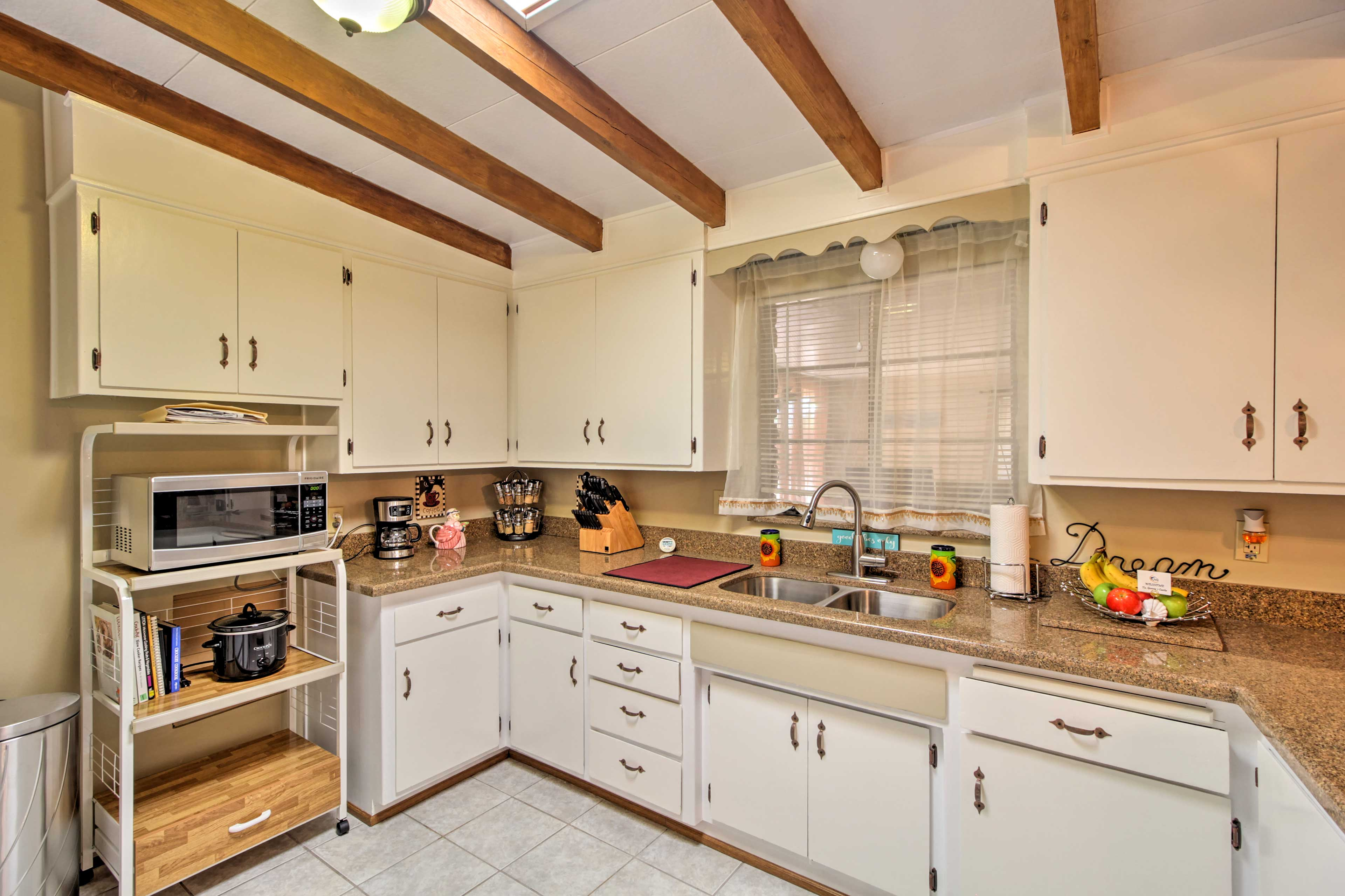 Cooking is a breeze with essential appliances and plenty of counter space.