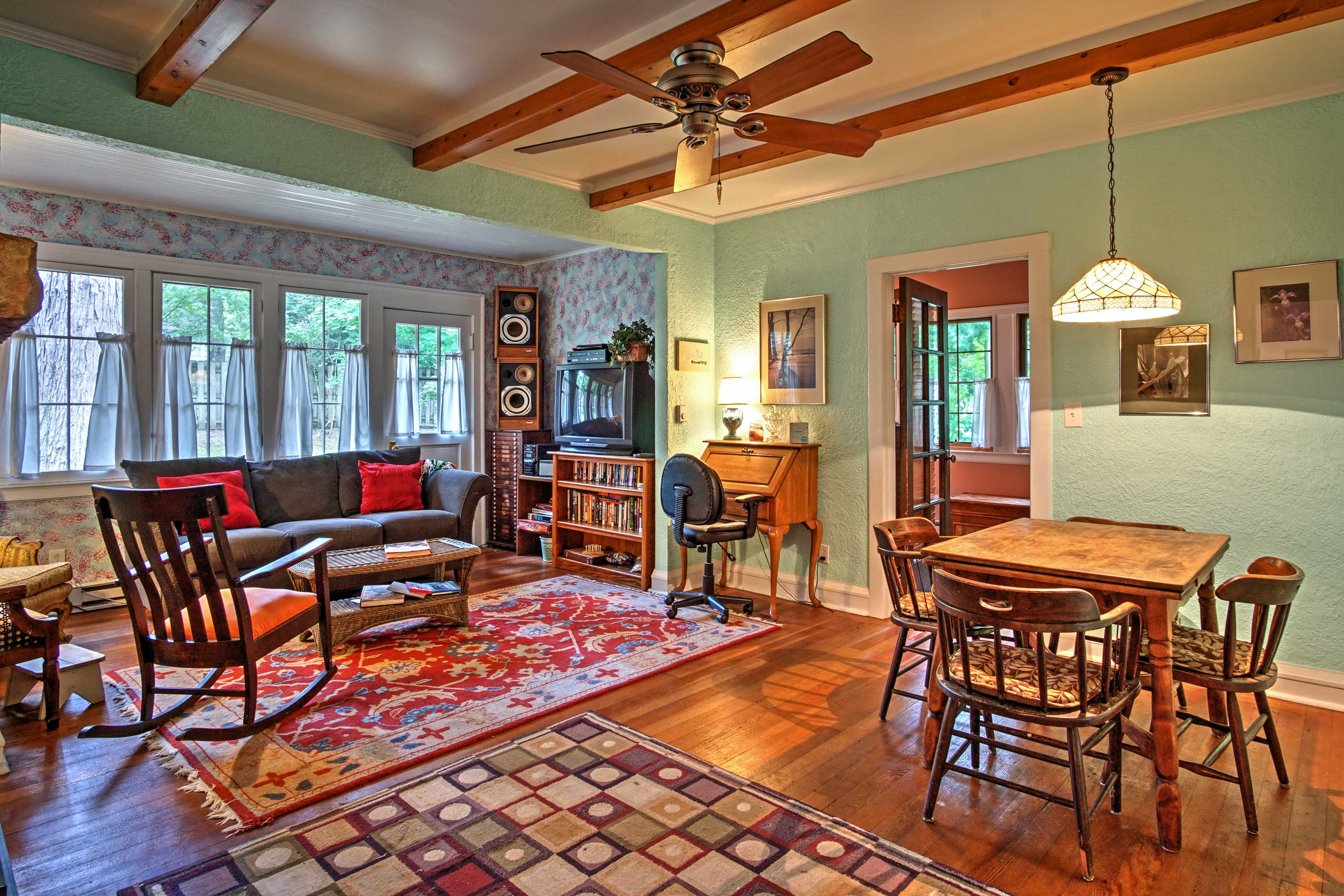 The living space features cozy  and traditional decor.