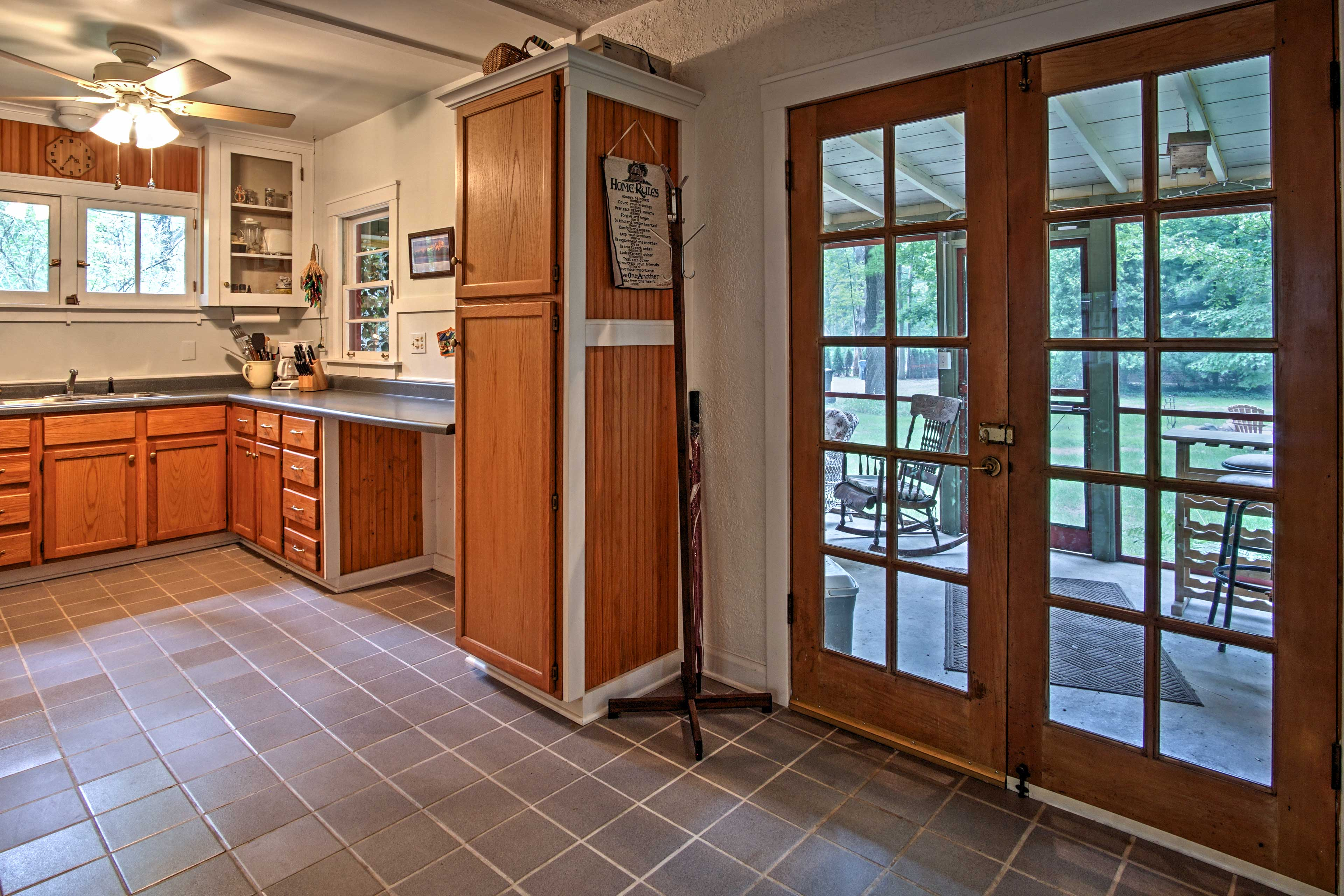 Just off of the kitchen is the screened-in porch.