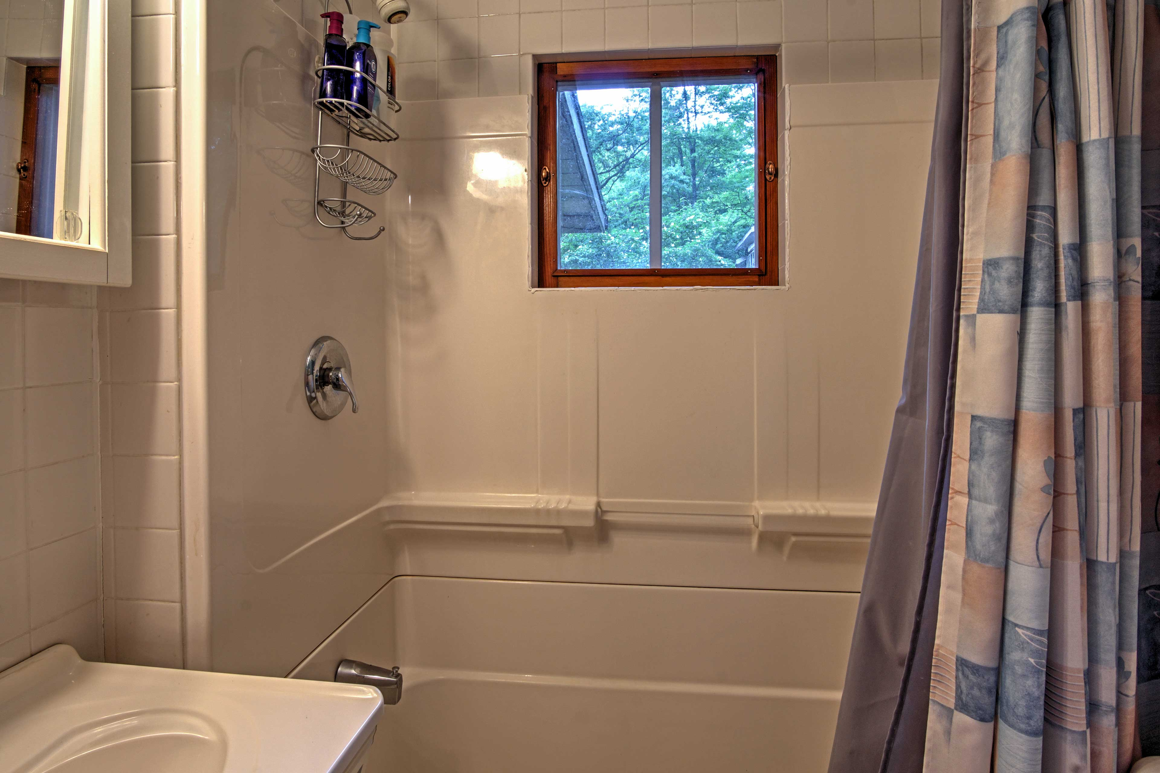Freshen up in the full bathroom that features a shower/tub combo.