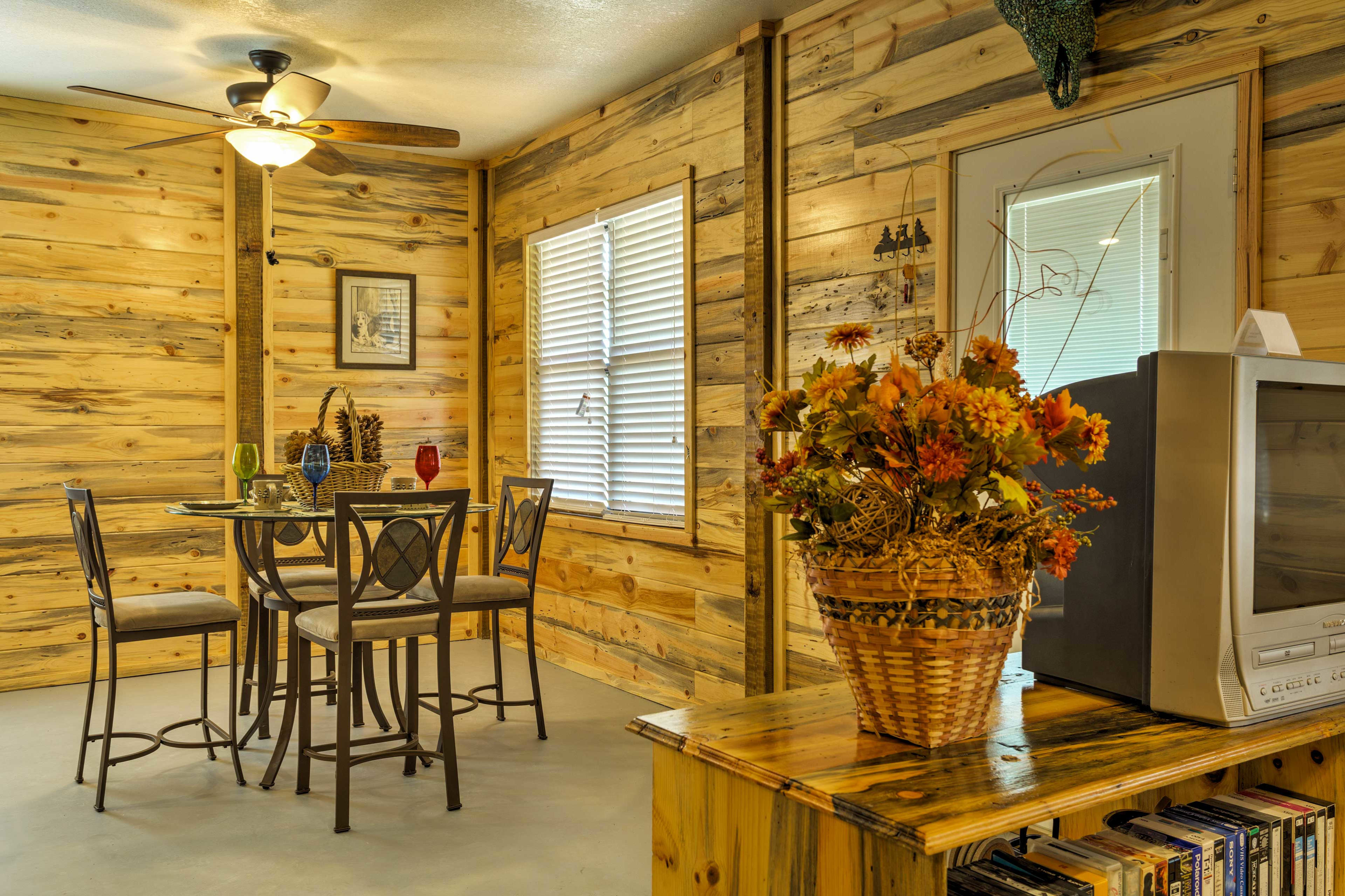 Wood walls and homey furniture make this the perfect lake house.