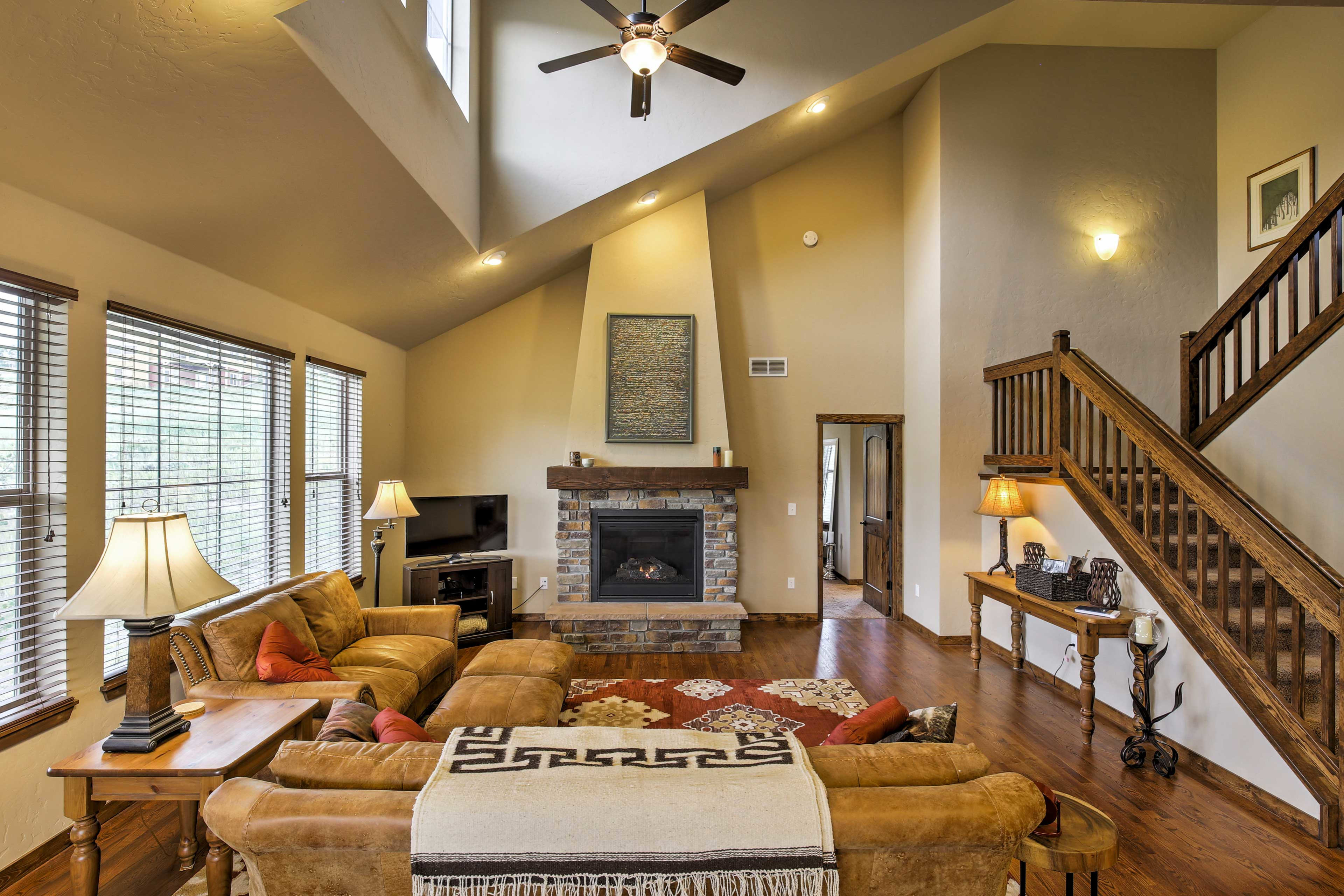Unwind in the spacious living area with a gas fireplace, comfy couches, and TV.
