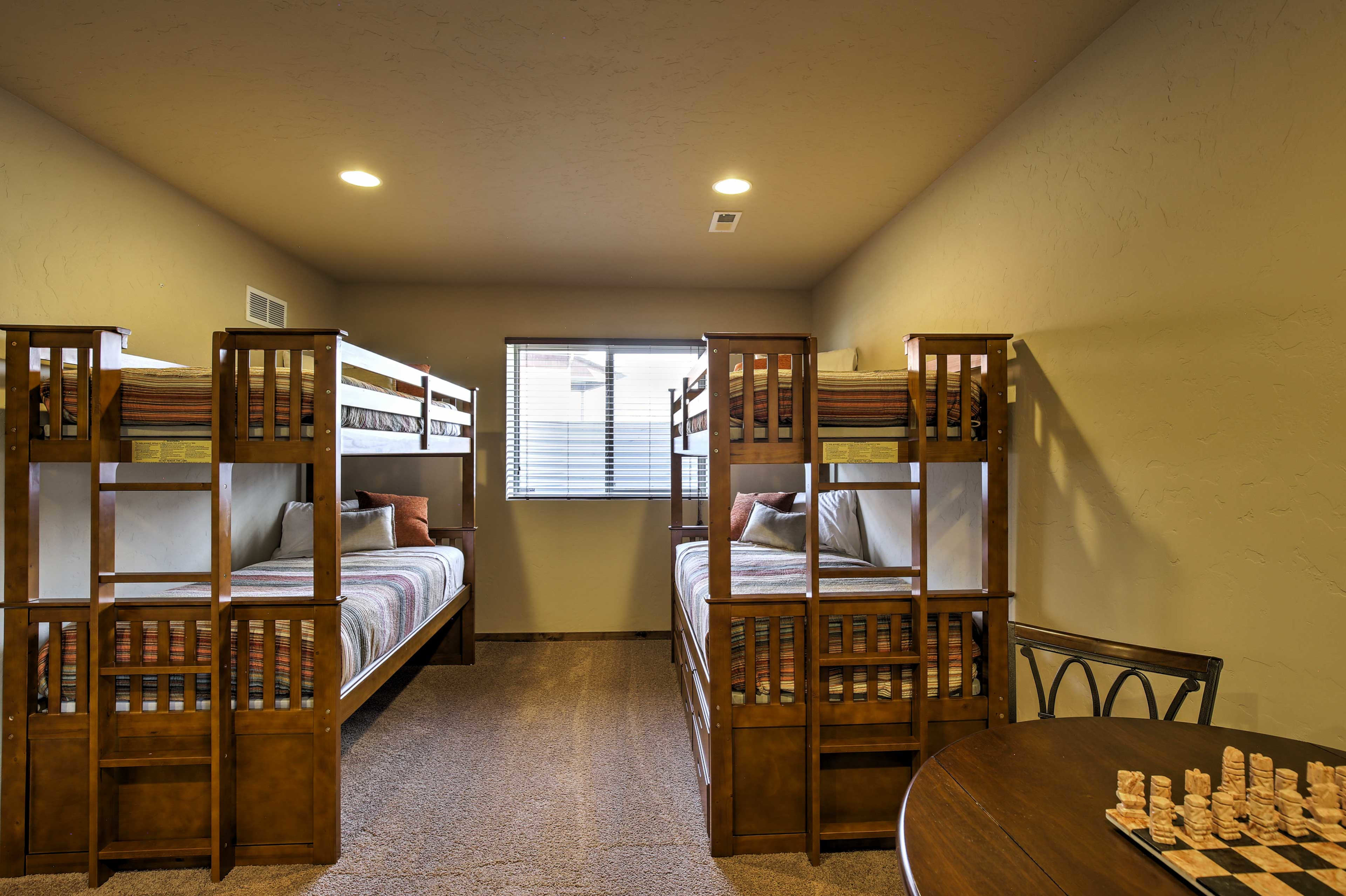 The basement has 2 twin-over-twin bunk beds and a twin trundle bed.