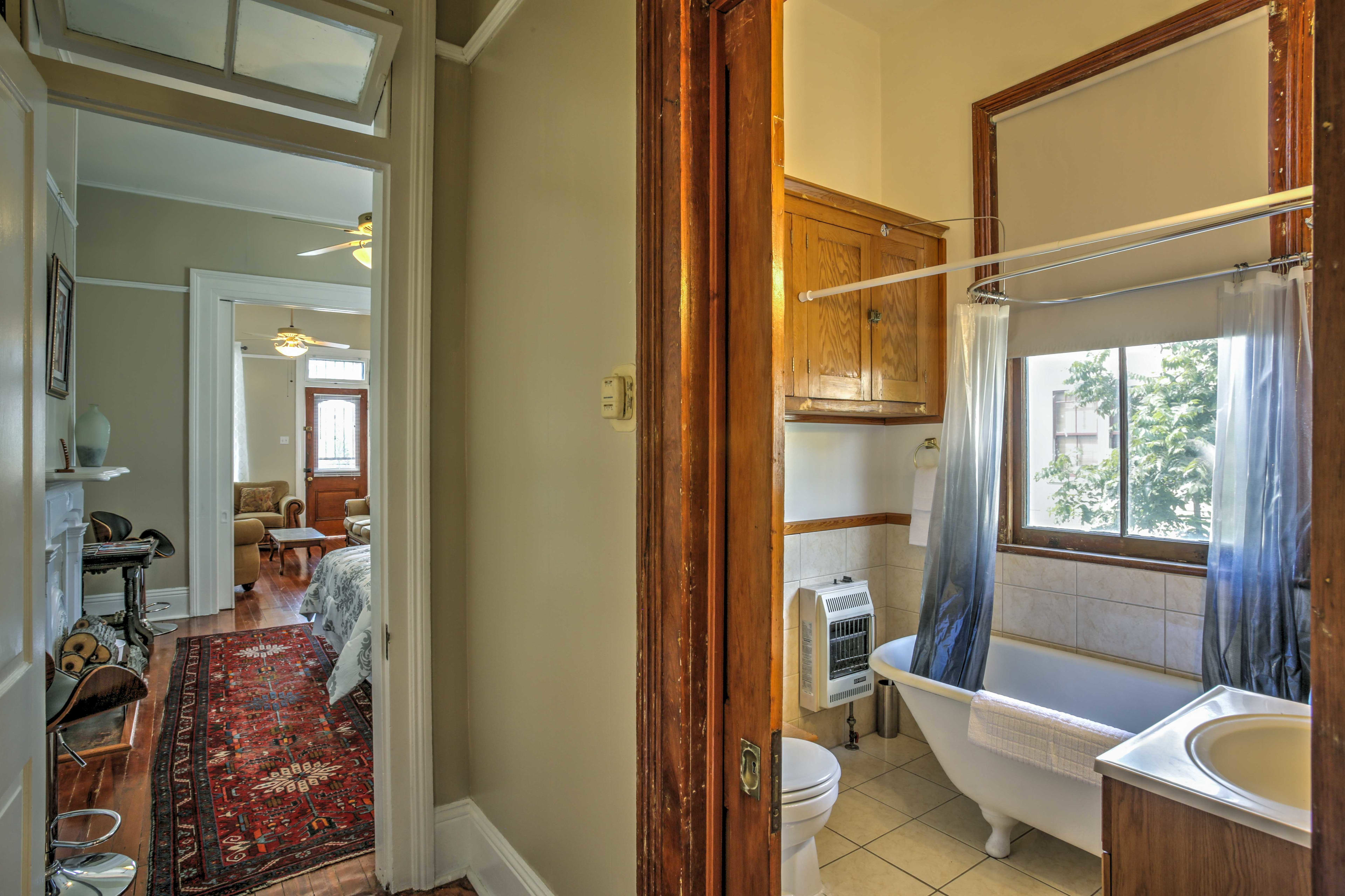 The bathroom is located in between the first and second bedrooms.