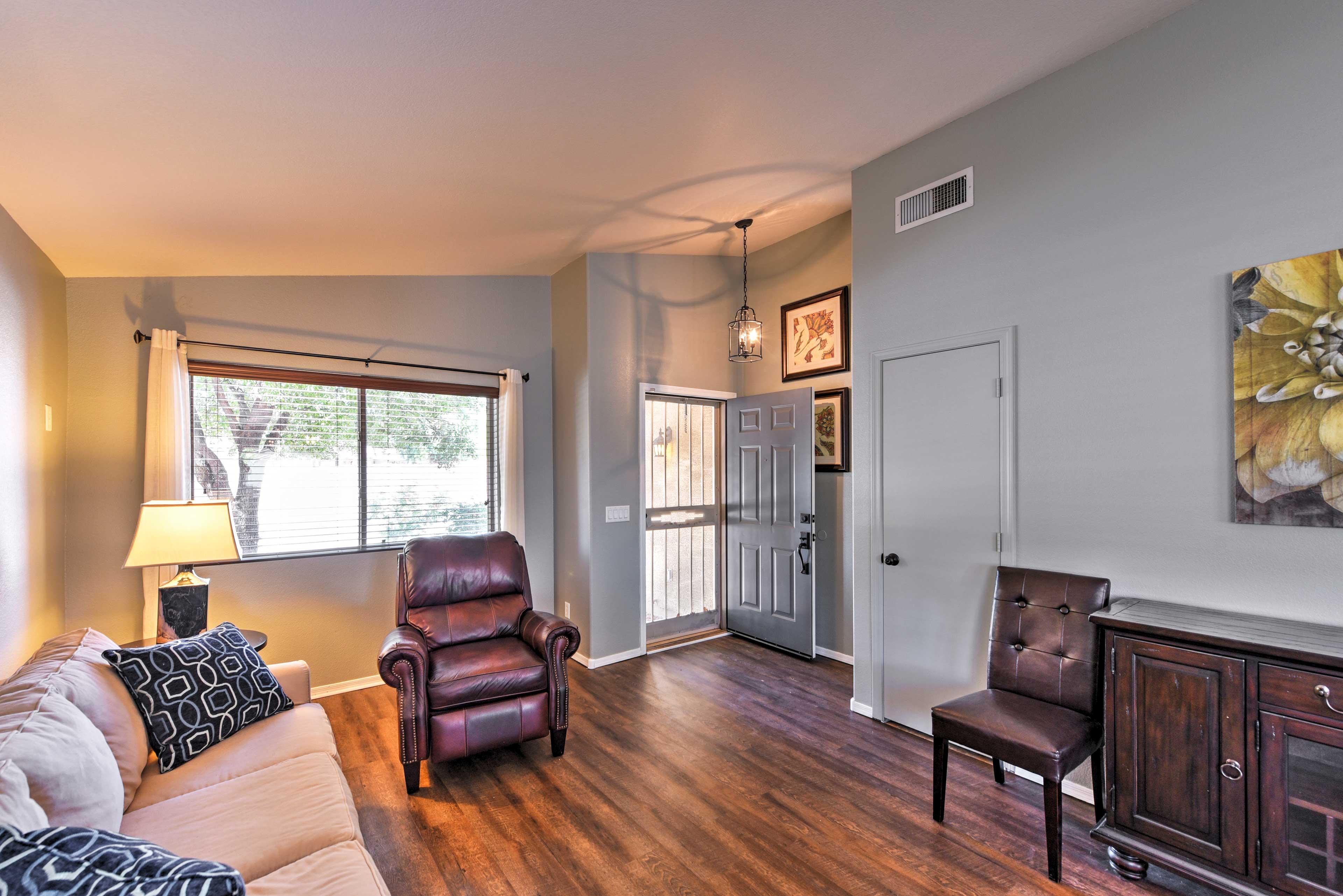 Enjoy an open-concept layout, hardwood floors, and elegant decor.