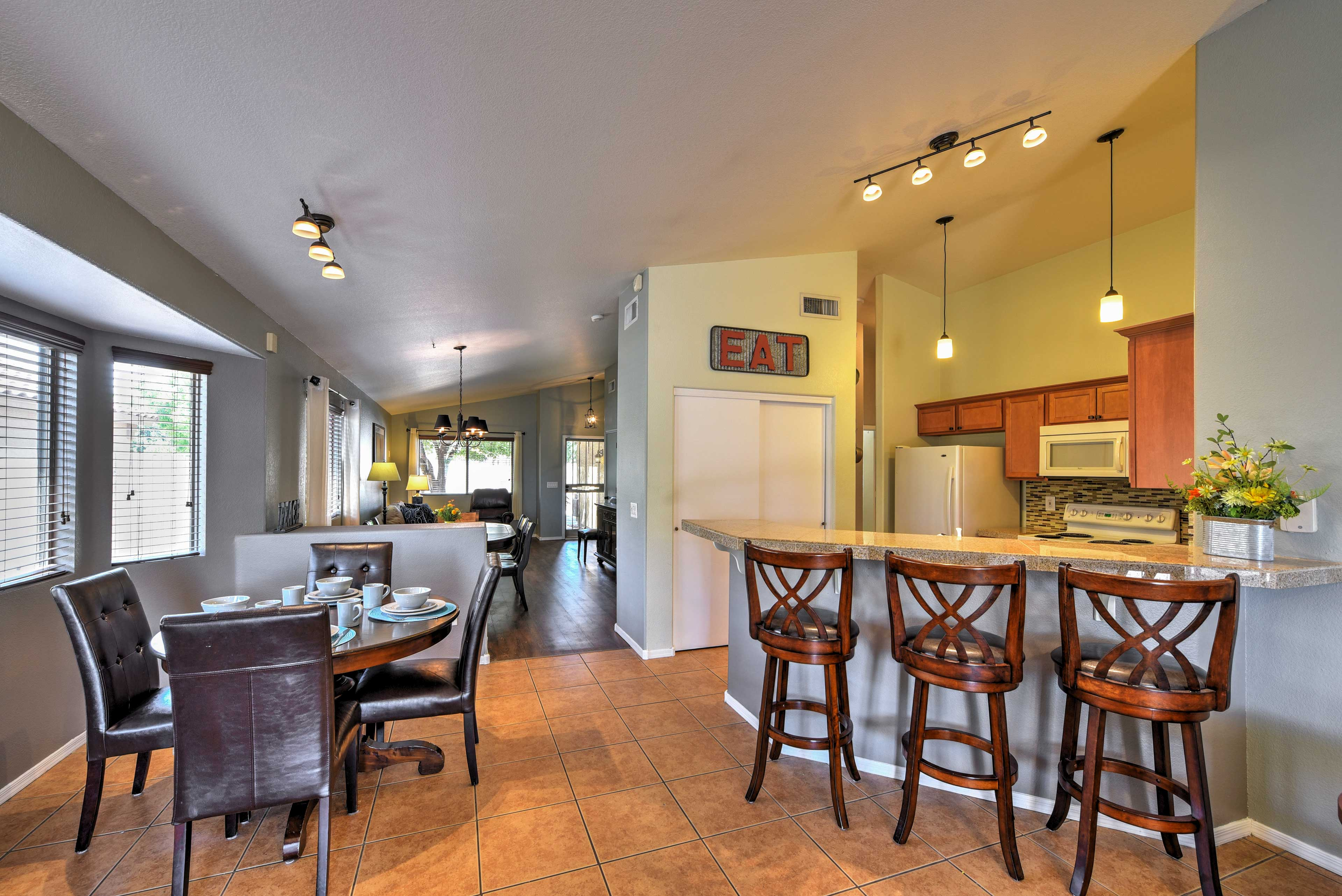 Another dining table can be found in the kitchen, along with a breakfast bar.