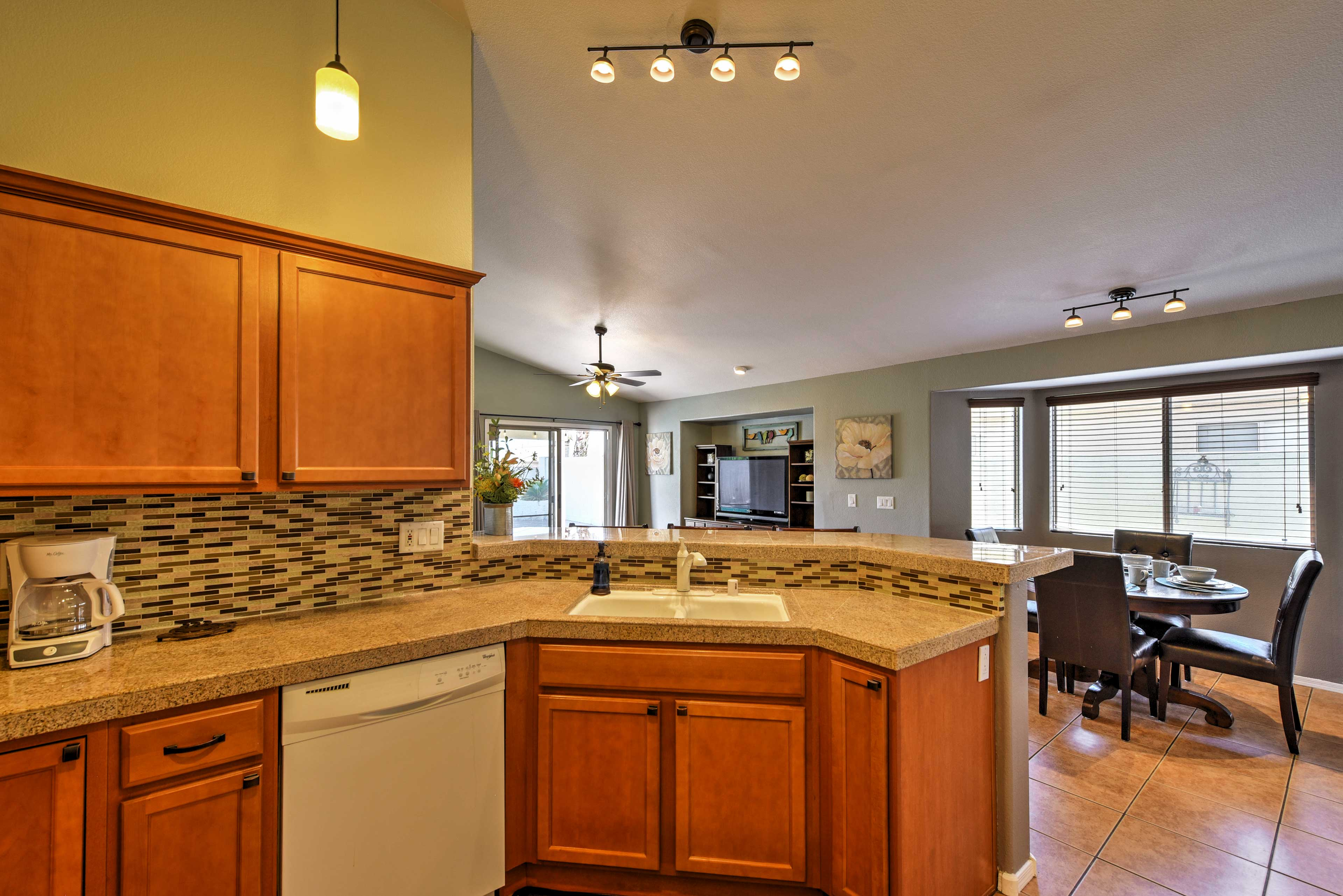 The home's kitchen features granite counters, and modern appliances.