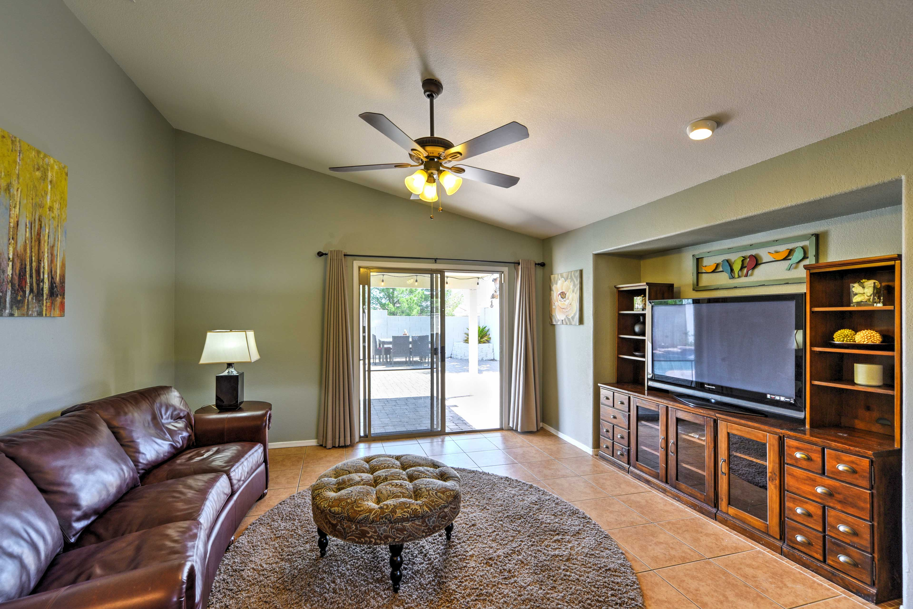 Head over to the living room to relax in front of the flat-screen TV