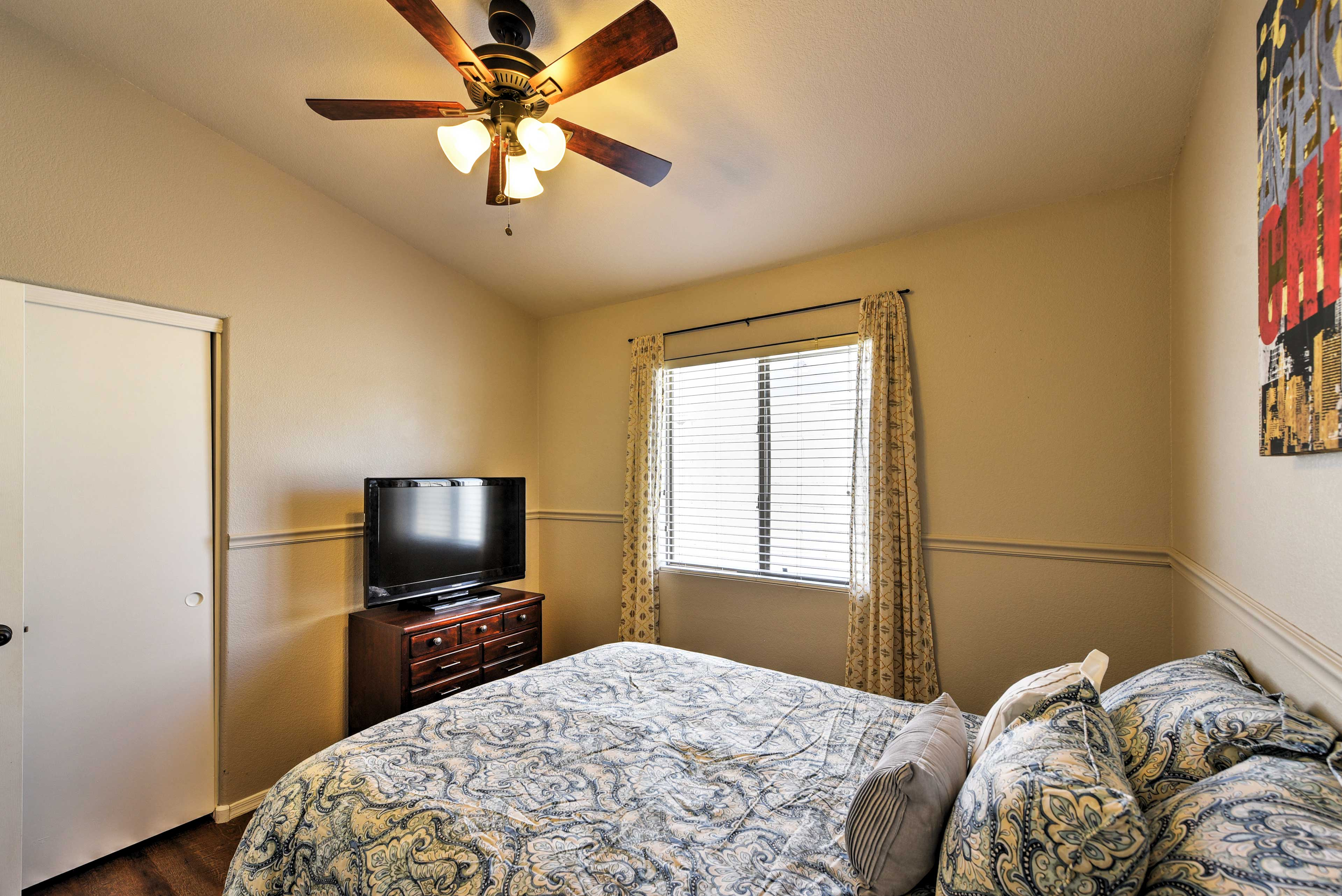 The second bedroom comes complete with a queen bed.