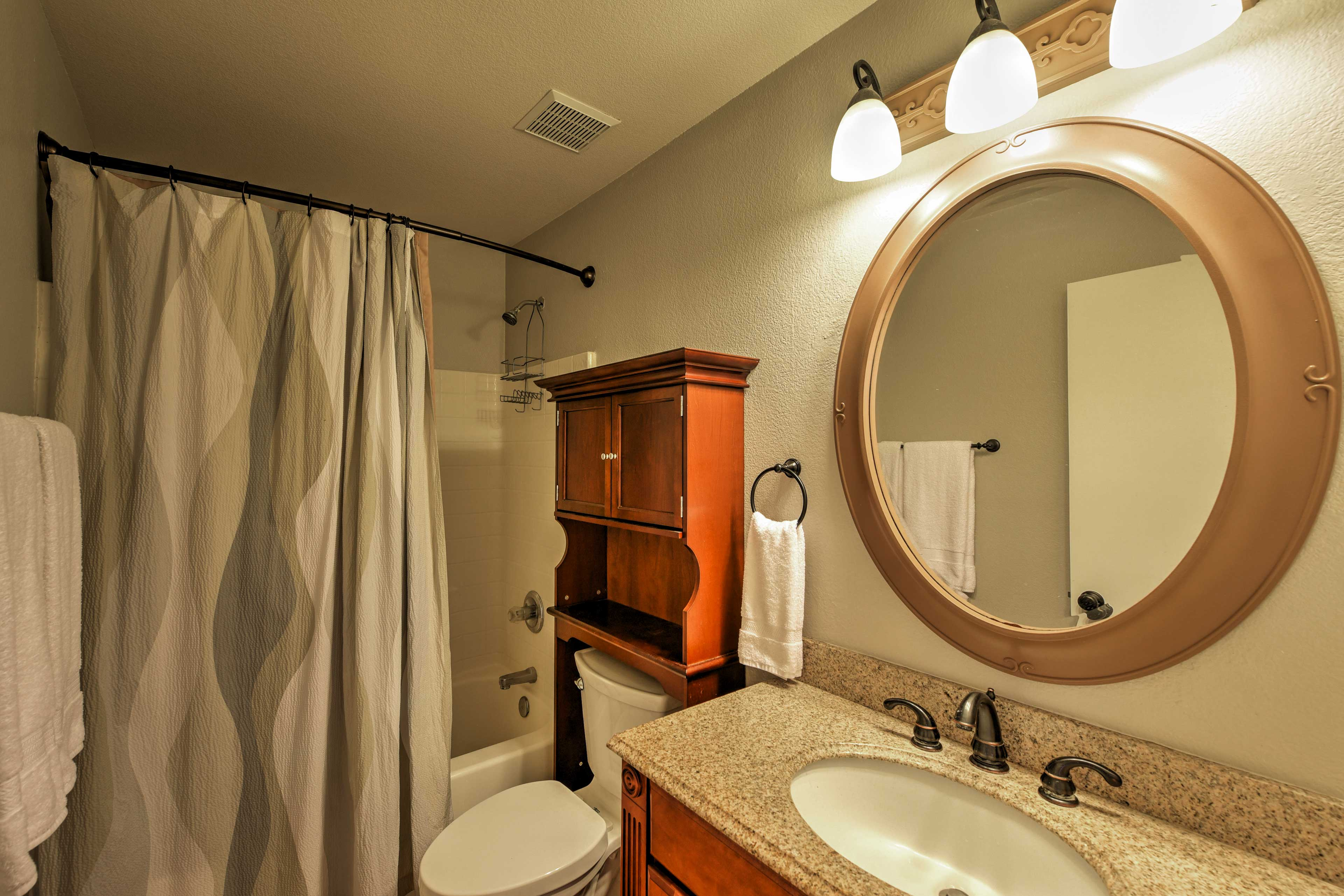 This second bathroom features a shower/tub combo and plenty of space to clean up