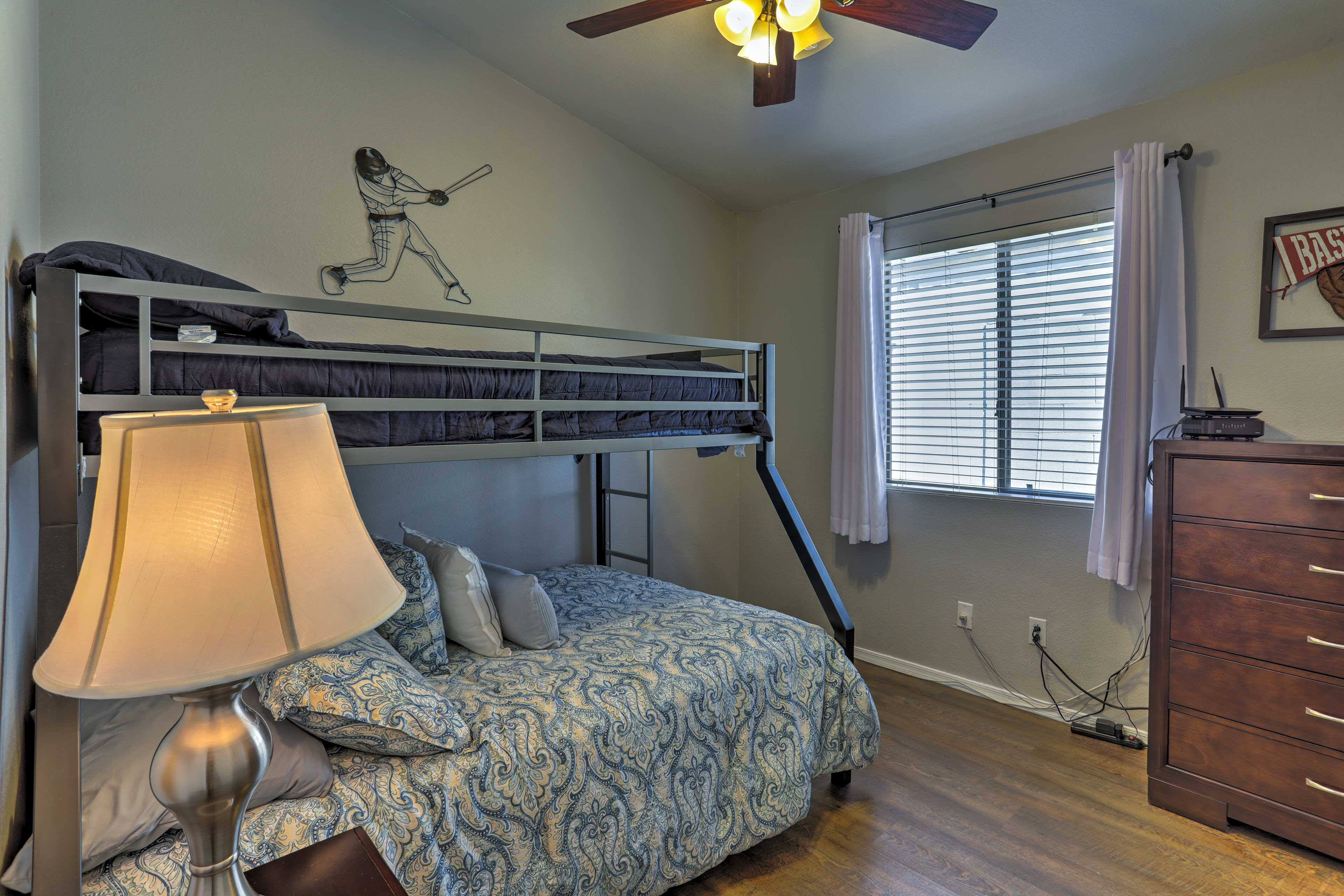 The third bedroom features a twin-over-full bunk bed.