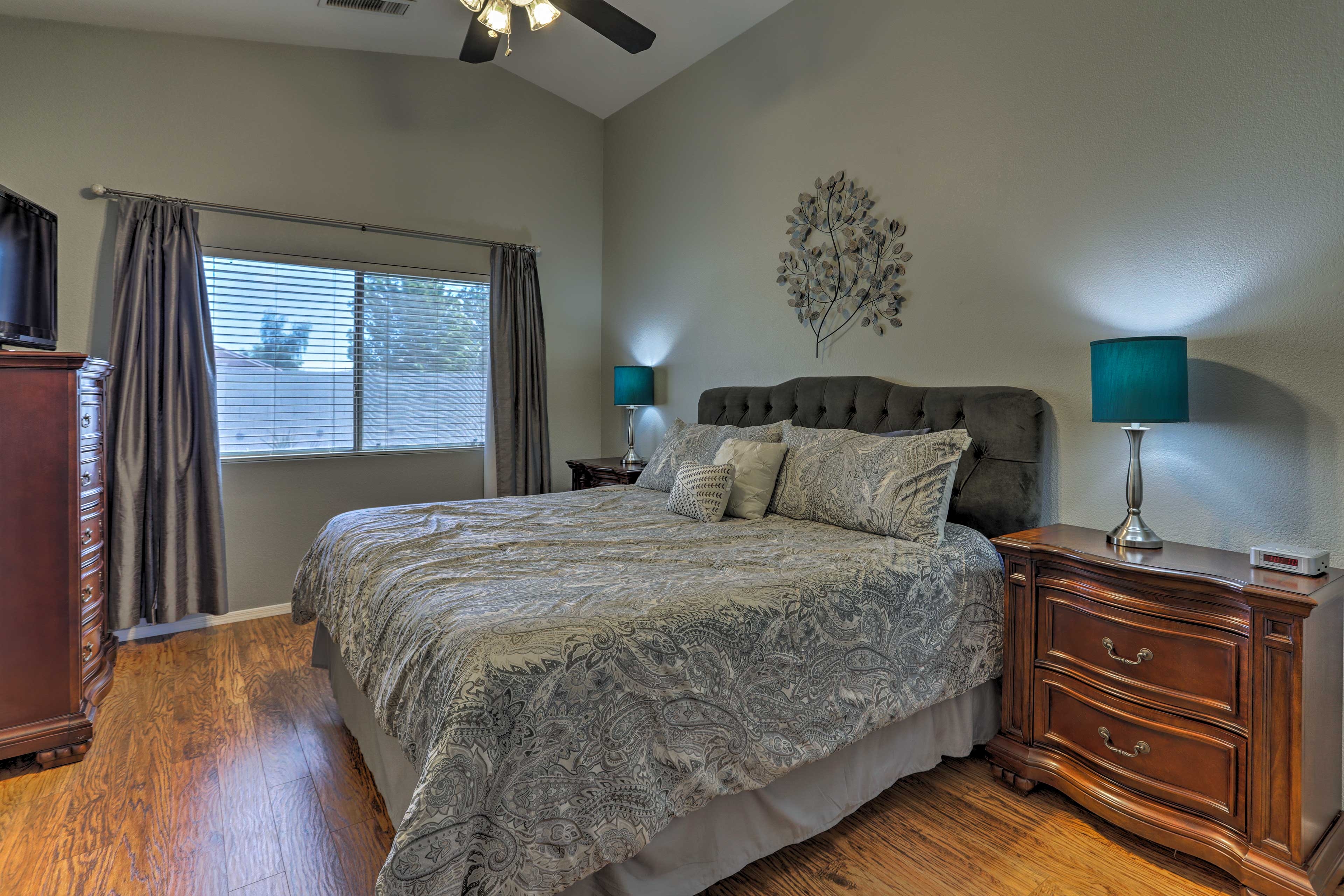 The master bedroom plays host to a king bed.