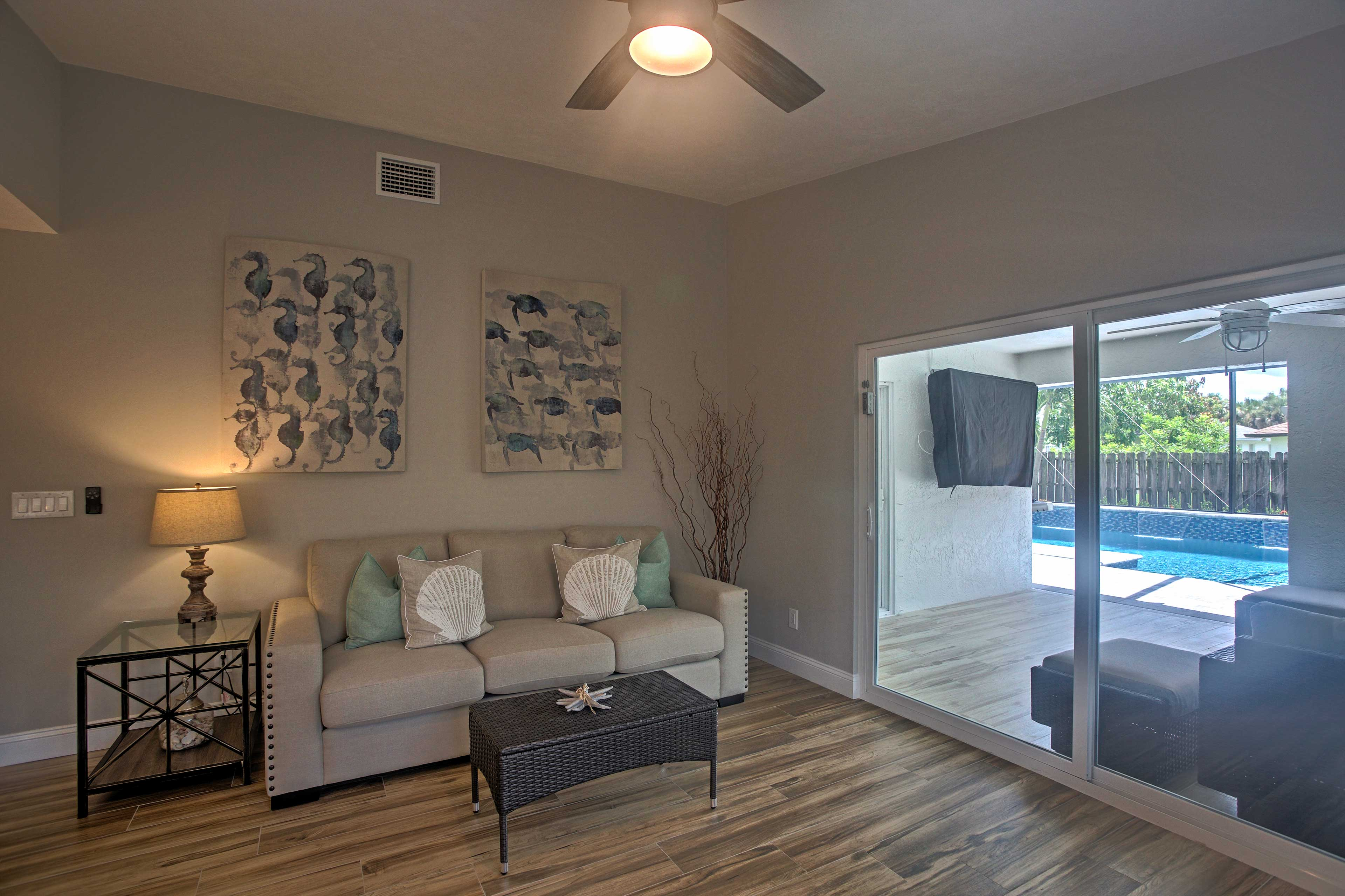 Another sitting area next to large glass doors fills the room with natural light