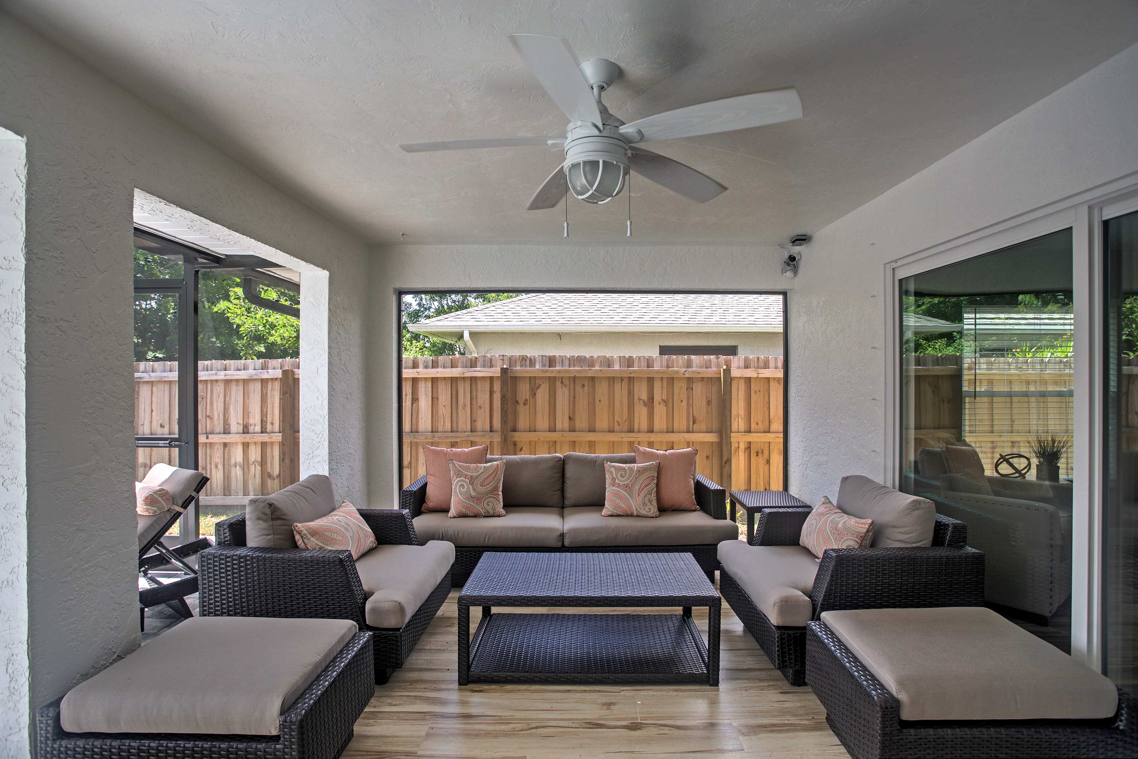 Spend afternoons lounging in the screened porch, which boasts large lanai doors.
