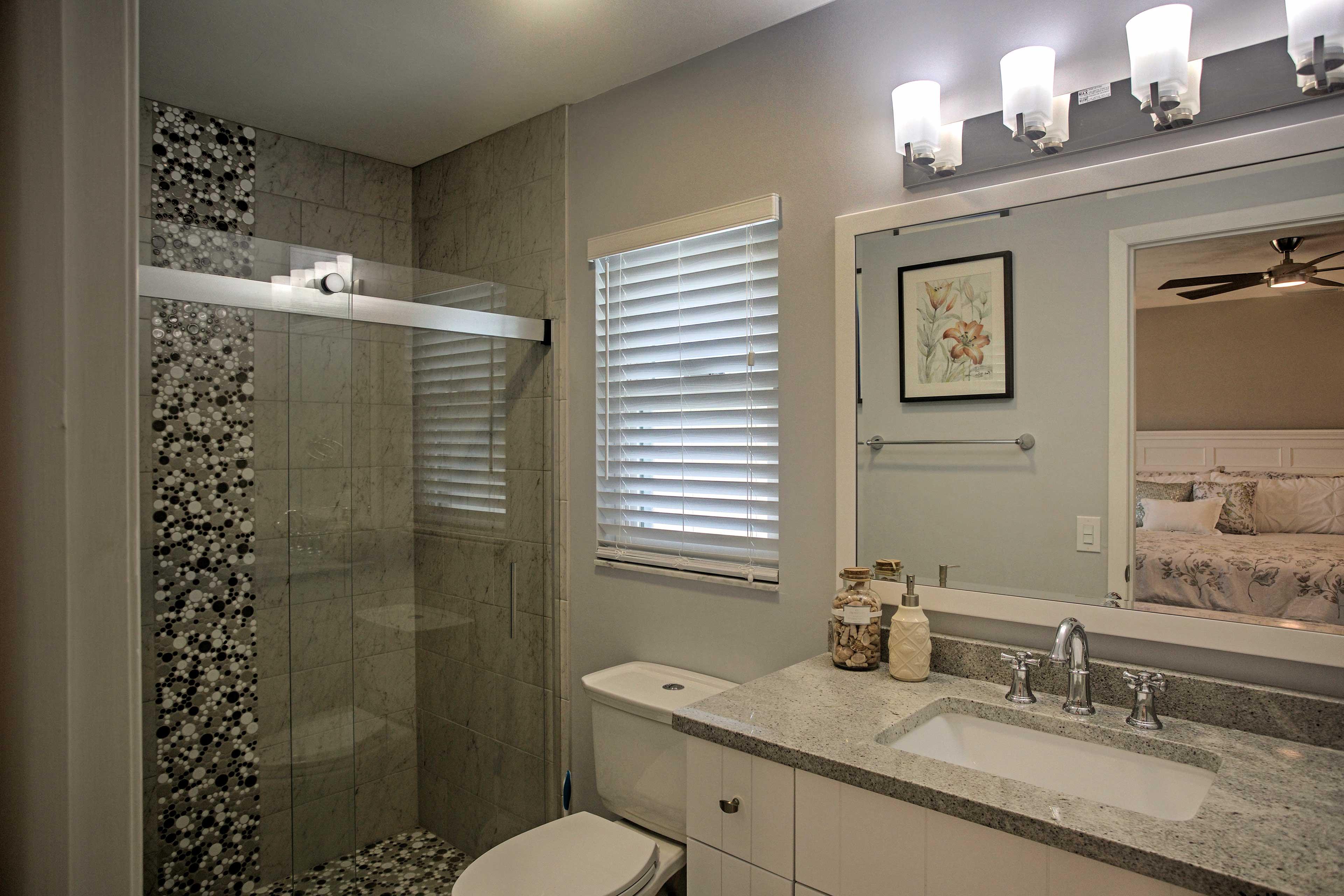 The master's en-suite bath boasts a pristine walk-in shower.