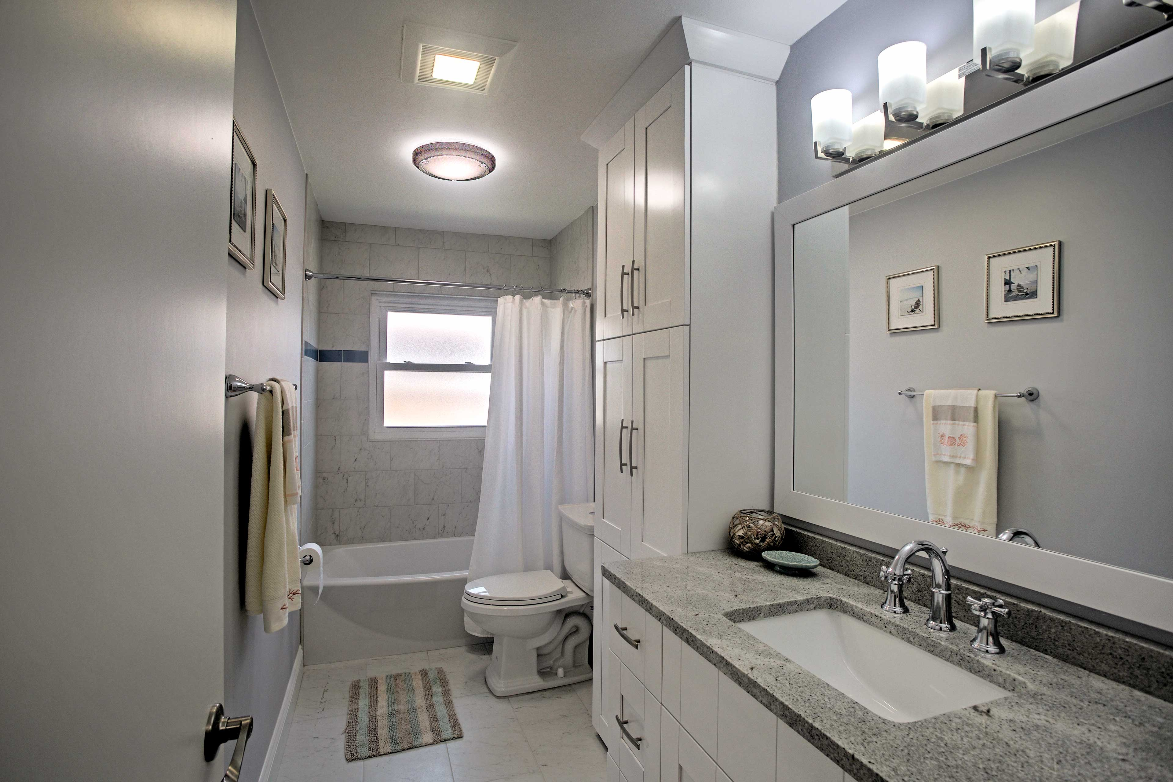 The second bathroom offers spacious accommodations to freshen up.