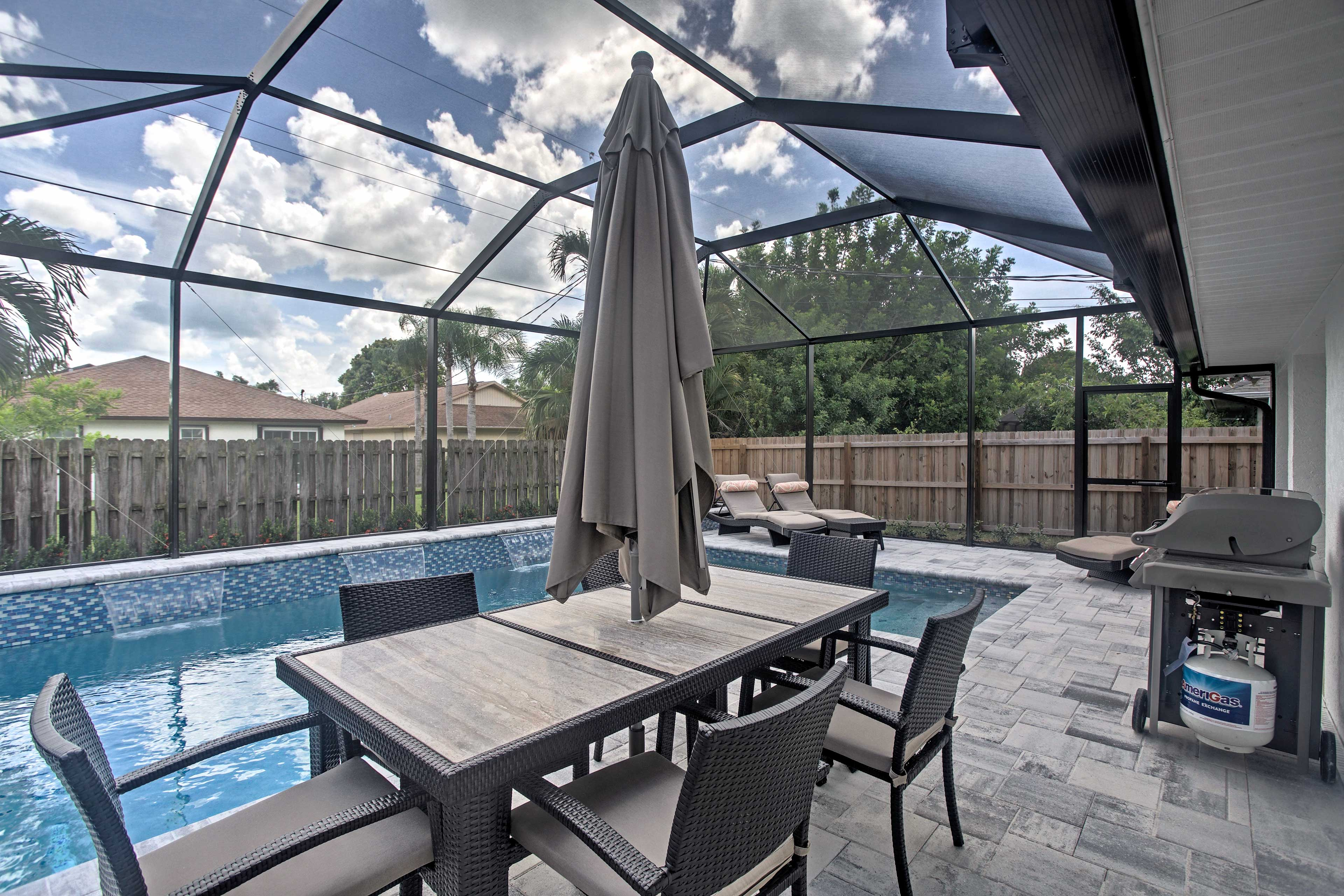 Head outside to this beautiful and private screen porch with outdoor seating.
